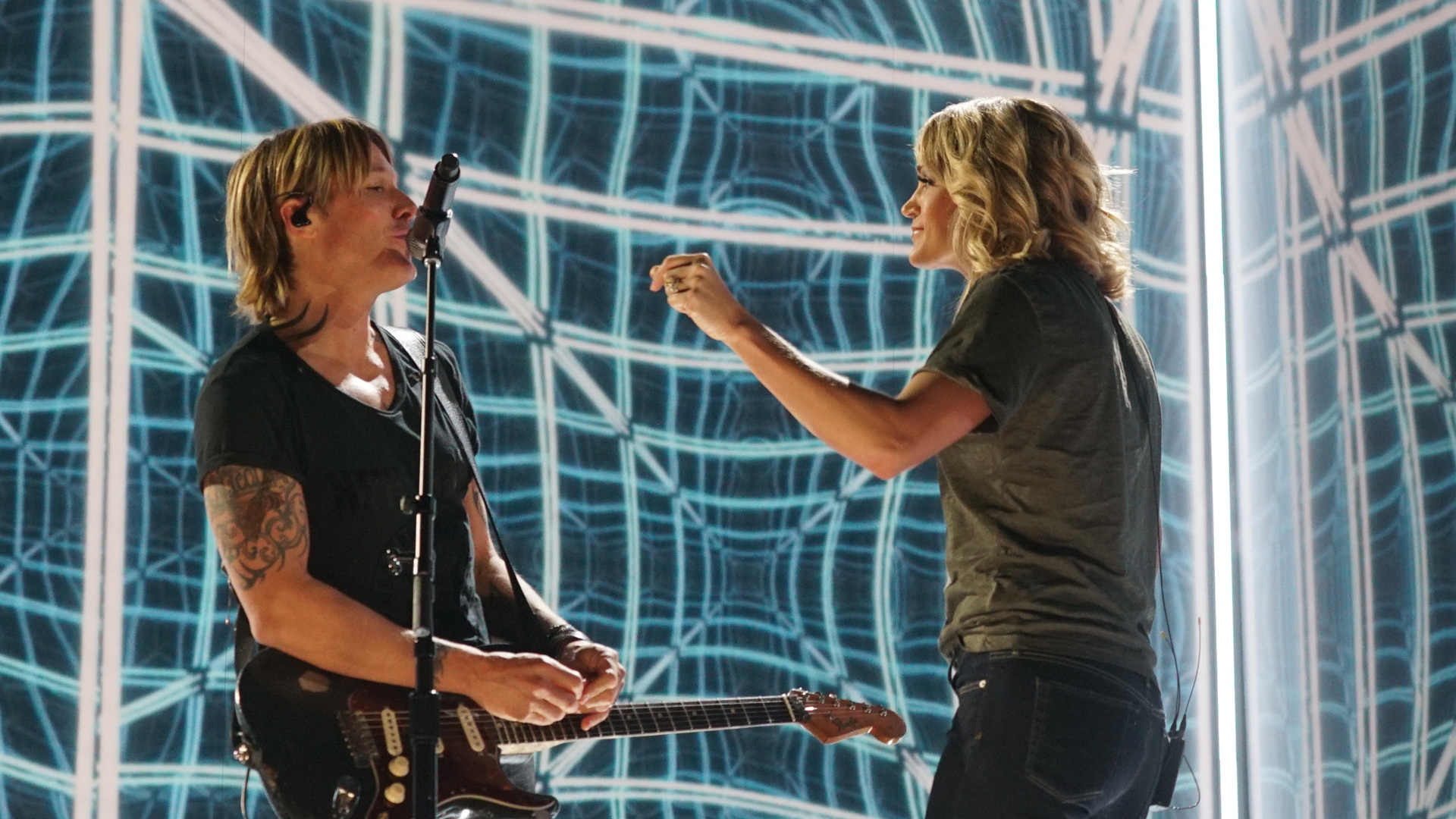 Current GRAMMY nominees Keith Urban and Carrie Underwood compare notes during rehearsals.