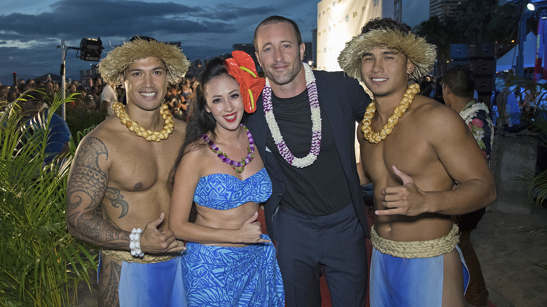 Alex O'Loughlin poses alongside a group dressed up for the festivities.
