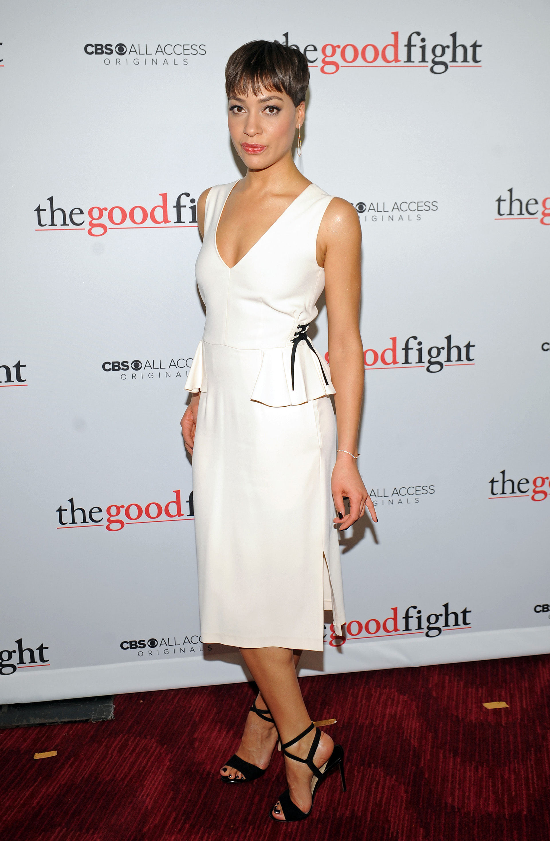 Cush Jumbo looks white hot in her peplumed a-line frock.