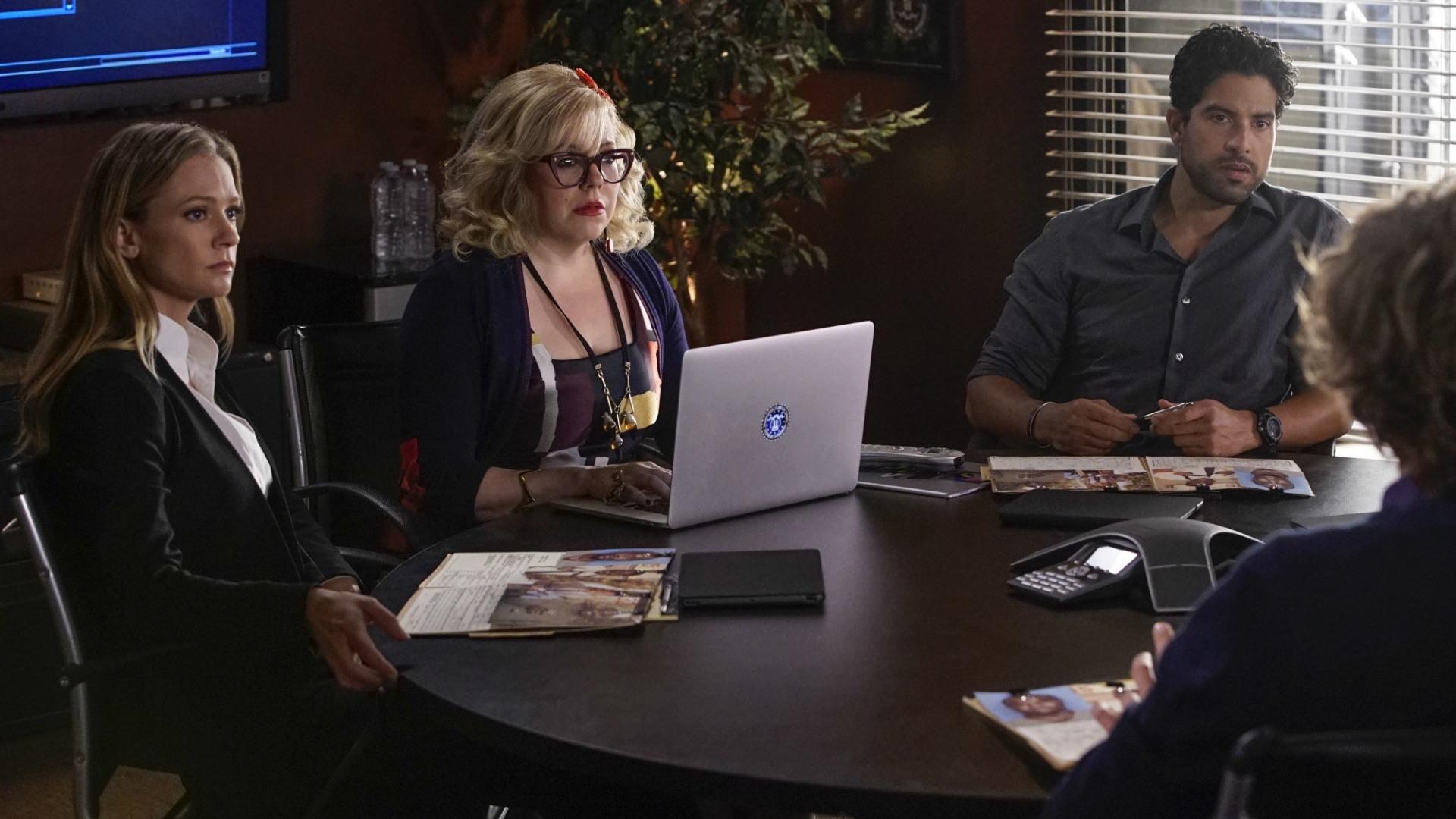 JJ, Garcia, and Alvez listen as Dr. Reid explains a theory.
