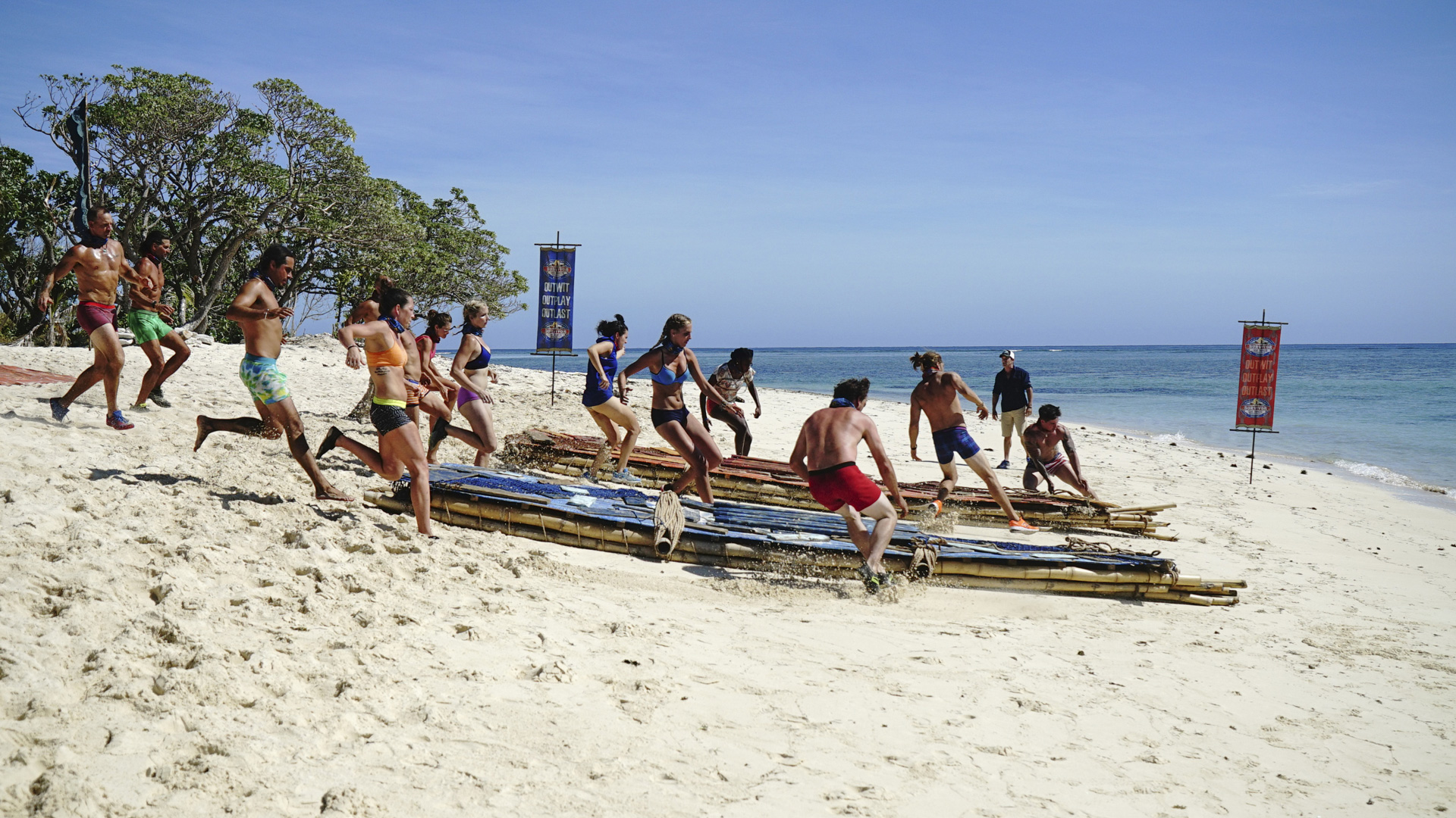 Each group races to their rafts and gets ready to paddle out.