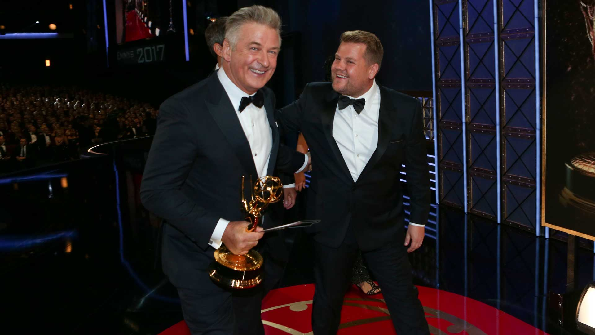 James Corden pats Alec Baldwin on the back he wins an Emmy for Outstanding Supporting Actor in a Comedy Series.