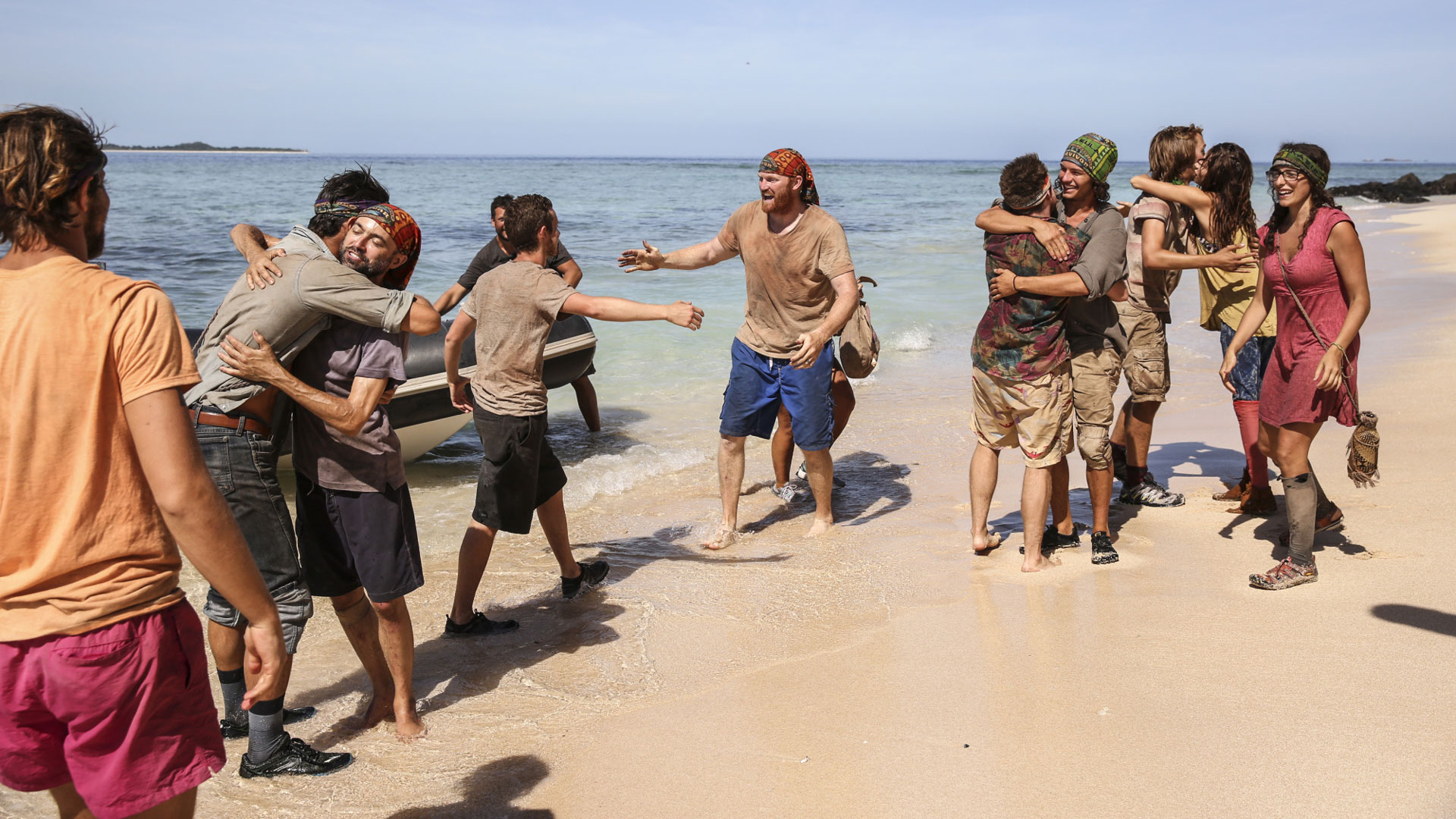 Adam and Chris go in for a hug while their fellow castaways do the same.