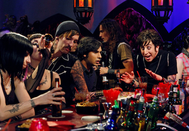 Question: When Howard and Raj go to a goth club, what do they have on their arms?