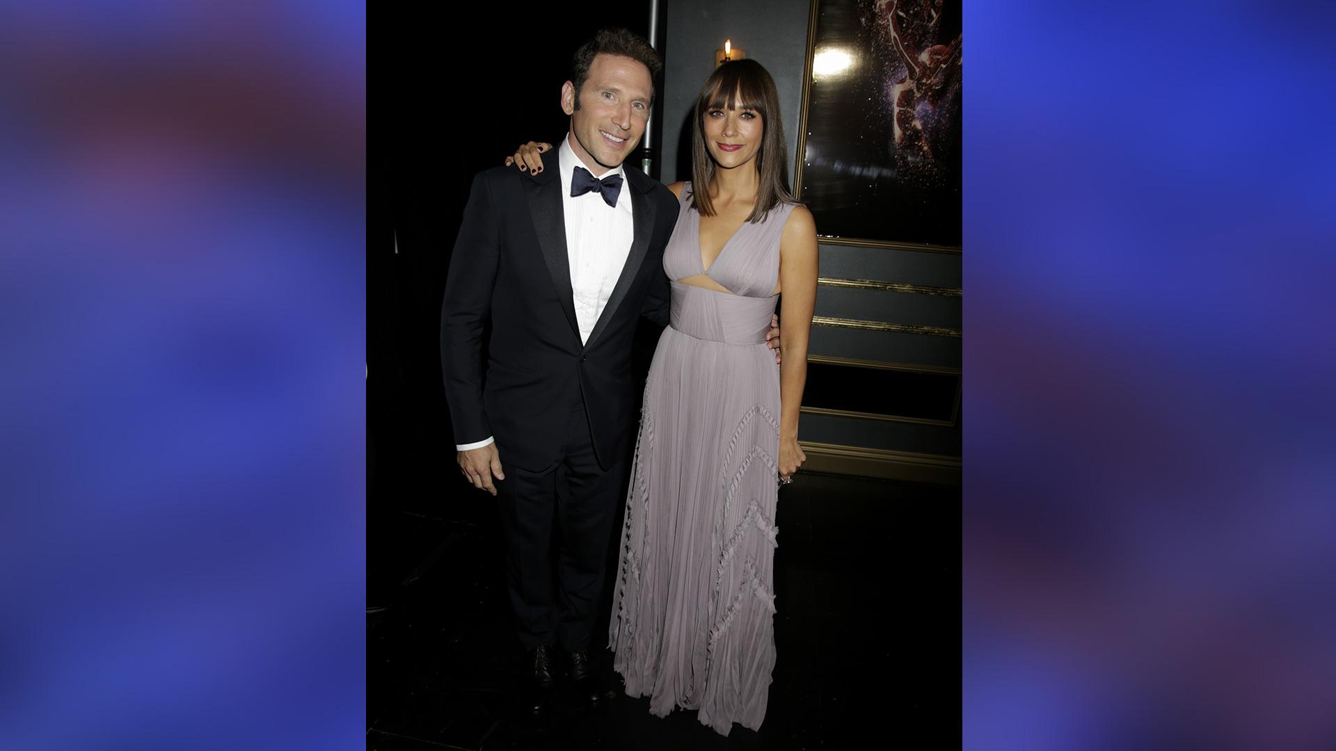 Emmy presenters Mark Feuerstein and Rashida Jones glow in their evening attire.