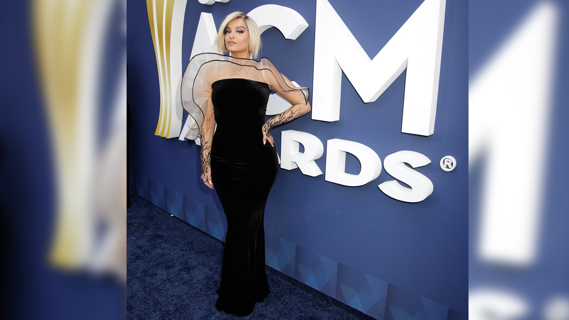 Pop singer Bebe Rexha knows how to make a statement while posing on the ACM red carpet.