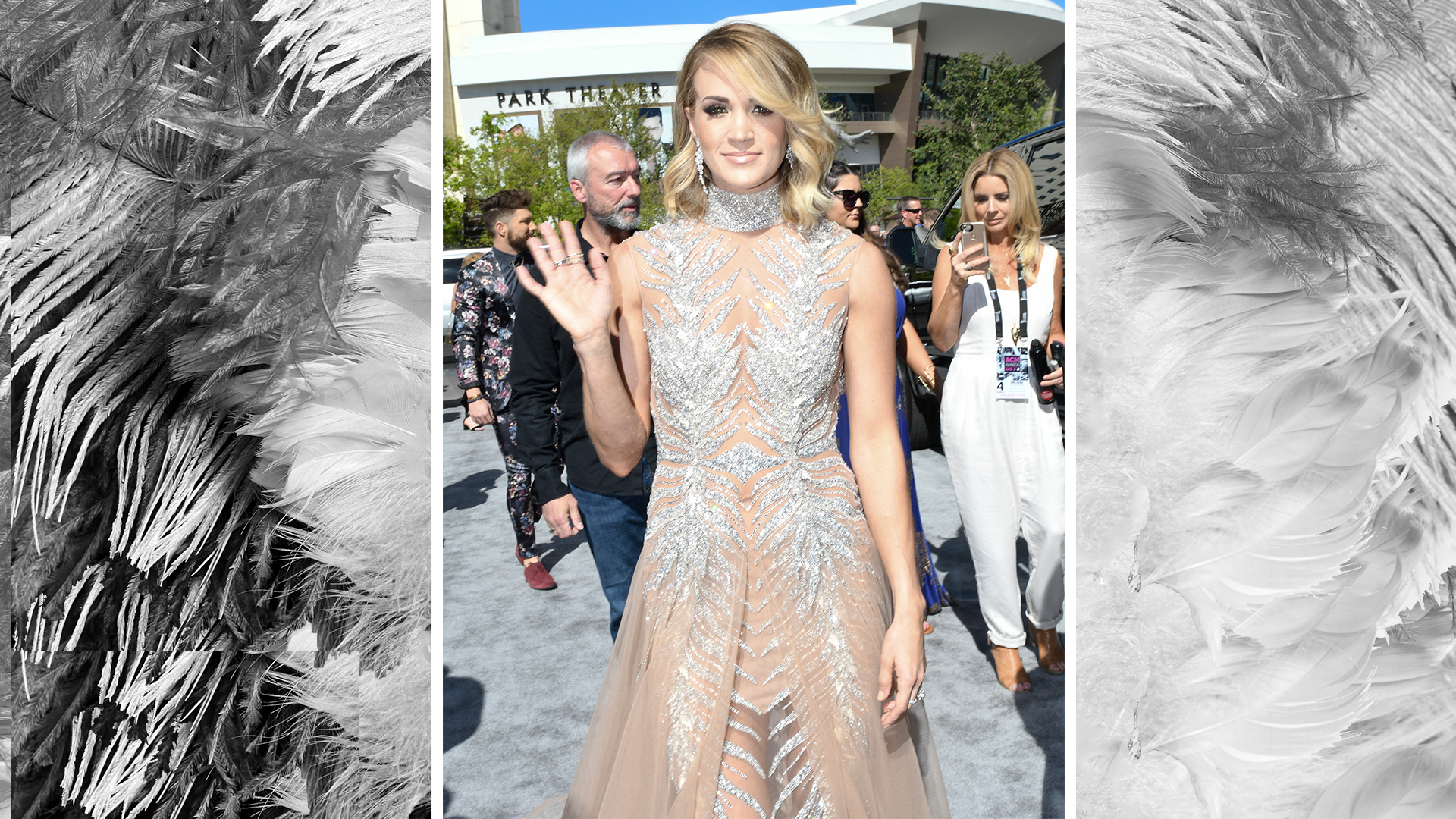 Carrie Underwood is a vision in a high-collared bedazzled gown.