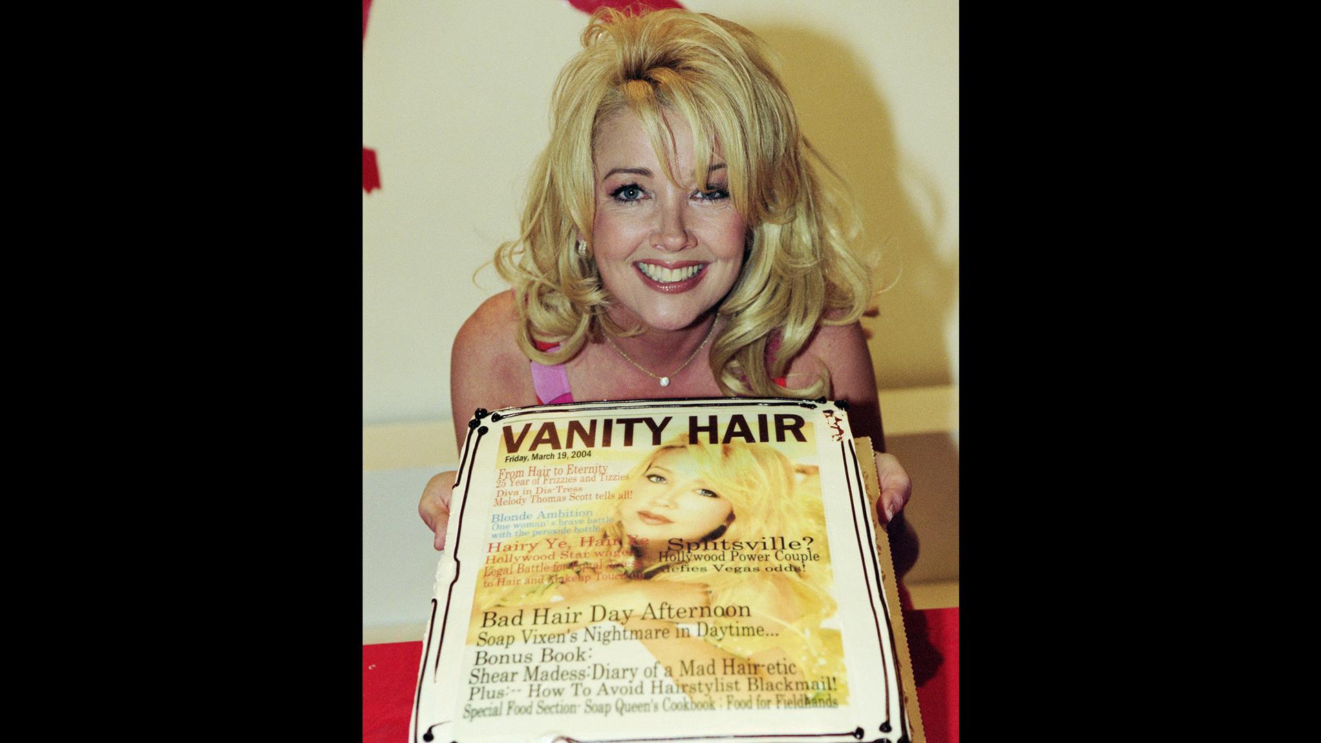 Melody Thomas Scott poses with her congratulatory cake honoring 25 years of Nikki Newman.