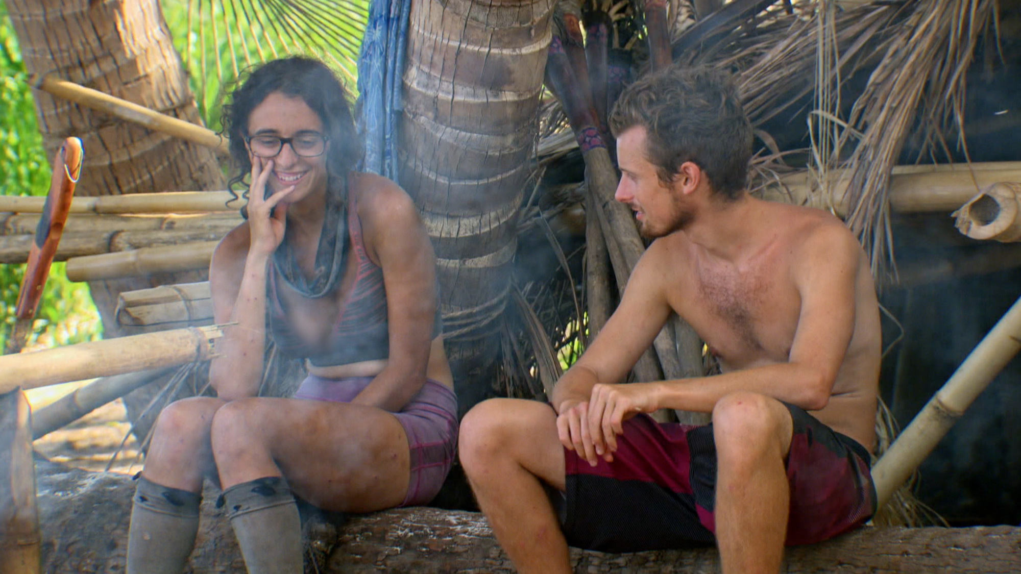 Hannah smiles as she shares a log with fellow Millennial Adam.