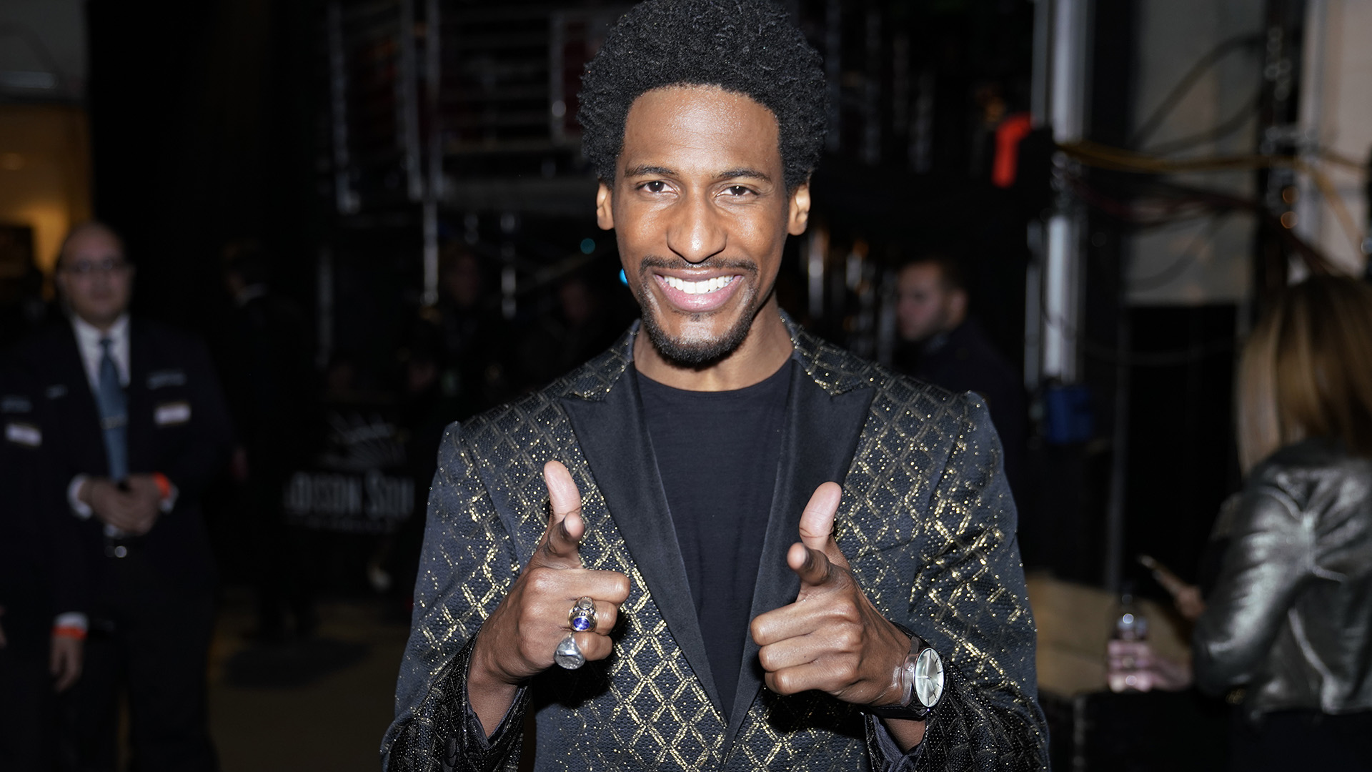 The Late Show with Stephen Colbert bandleader Jon Batiste flashes his pearly whites backstage.