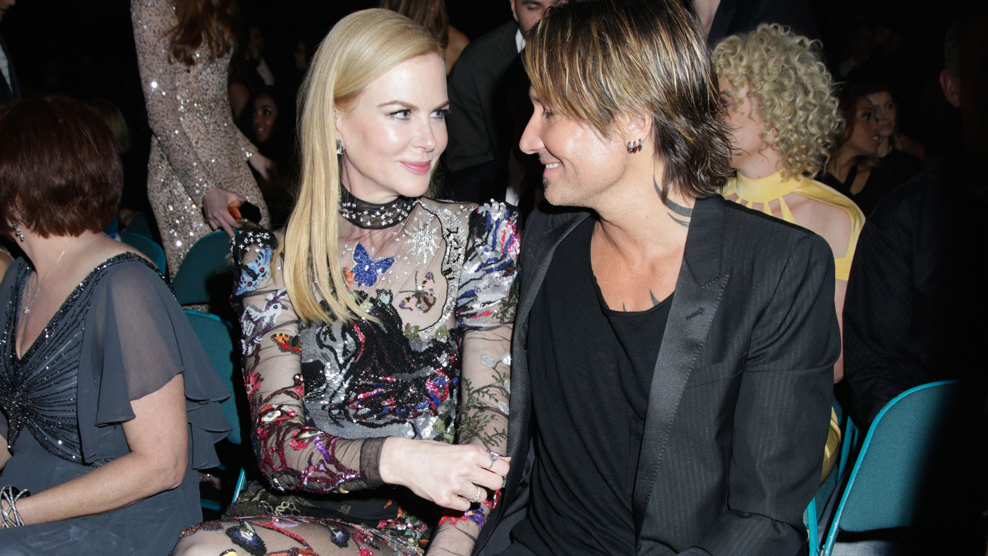 Actress Nicole Kidman exchanged loving glances with her husband, singer Keith Urban, before he took to the ACM stage to perform