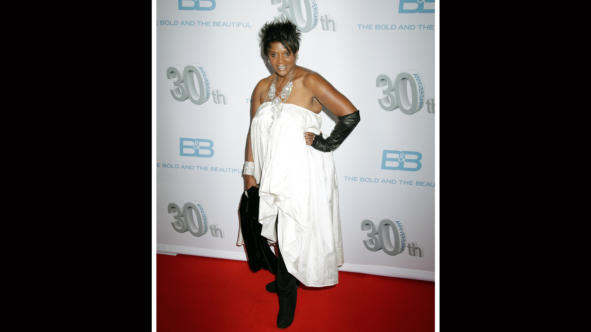 Anna Maria Horsford accessorizes her strapless white dress with a chunky, funky necklace.