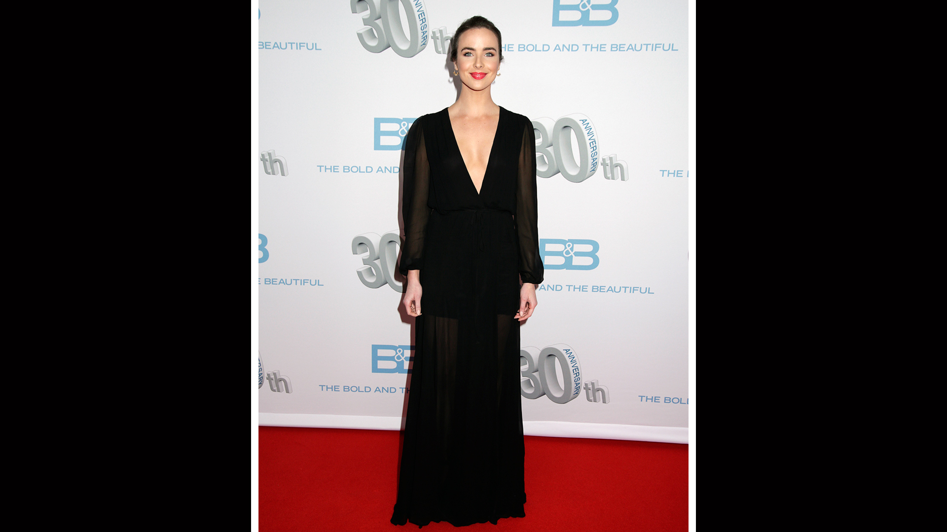 Ashleigh Brewer lets a plunging neckline and sheer sleeves do all the talking.