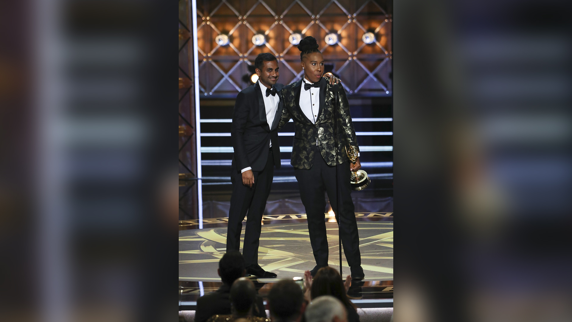 Lena Waithe and Aziz Ansari win Outstanding Writing for a Comedy Series at the 69th Emmy Awards.