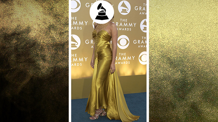 Who wore this golden gown with a high-drama neckline and glittering heels?