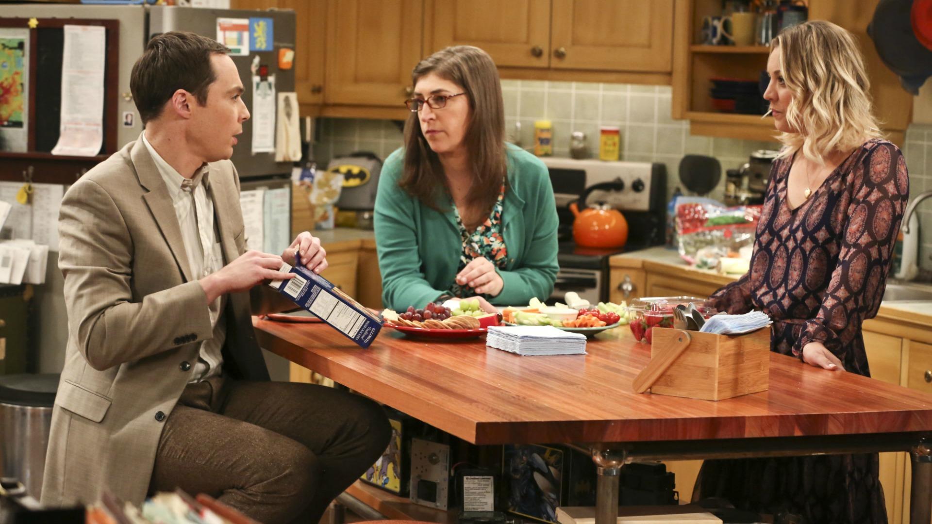 Sheldon helps prepare the pre-dinner spread.