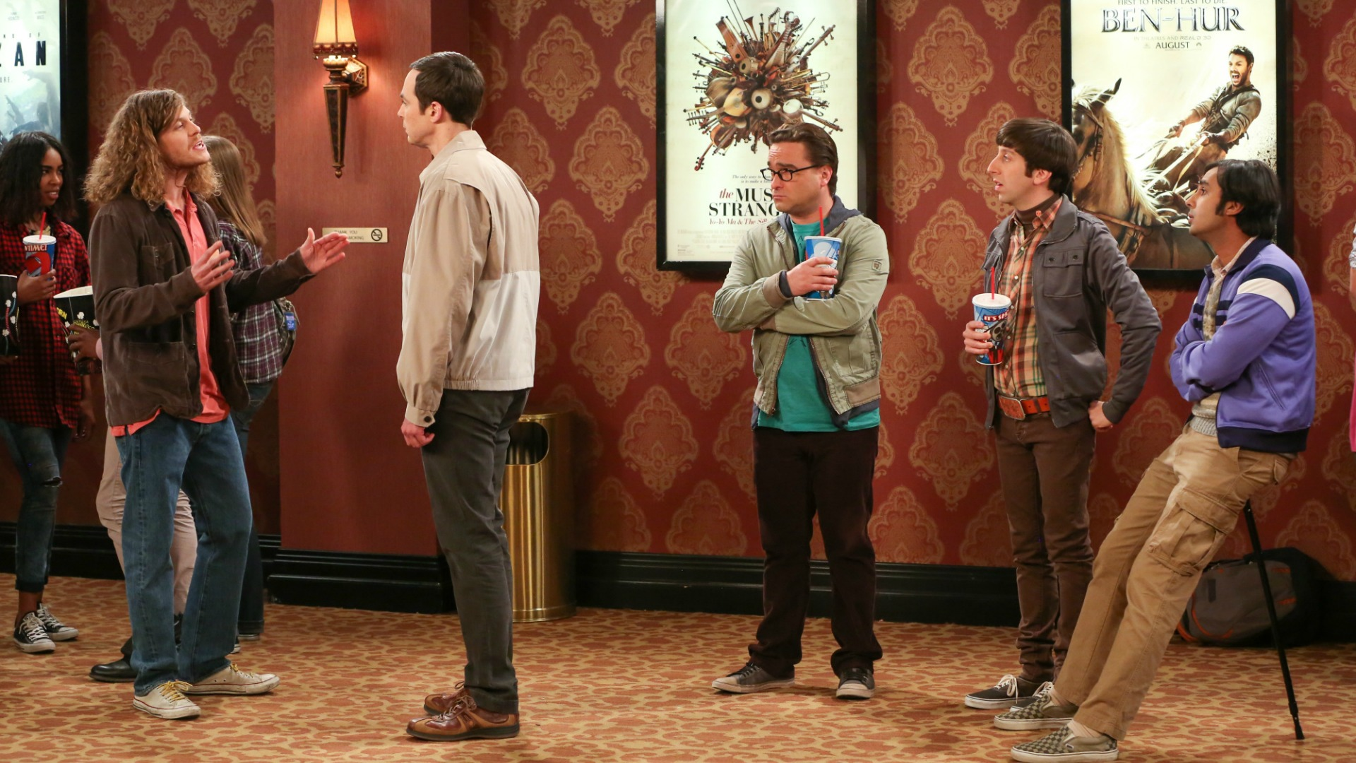 Sheldon has words with another movie-goer in line.