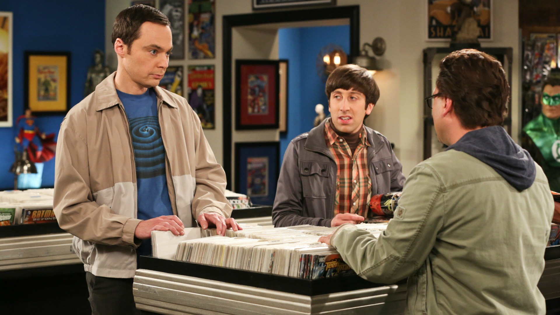 Something surprises Sheldon while sorting through the comics.