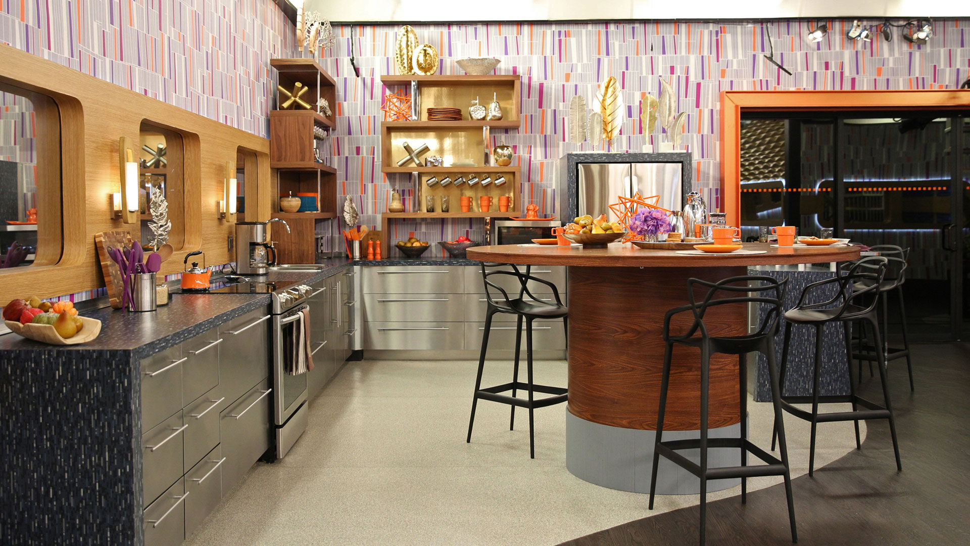 Gone is the jet-engine kitchen centerpiece and in its place is a wood-based island.