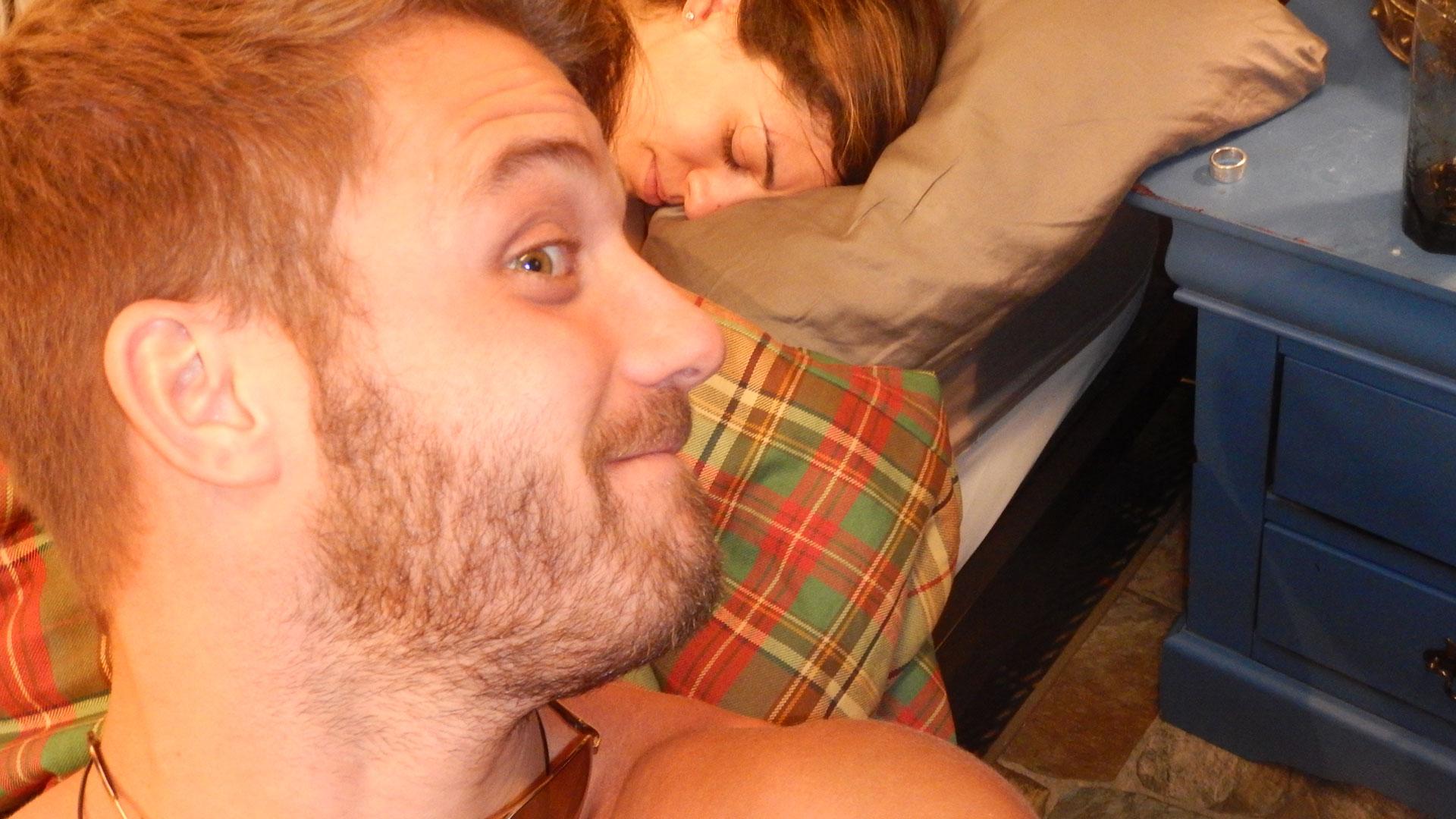 Paulie peers over a snoozing Bronte.