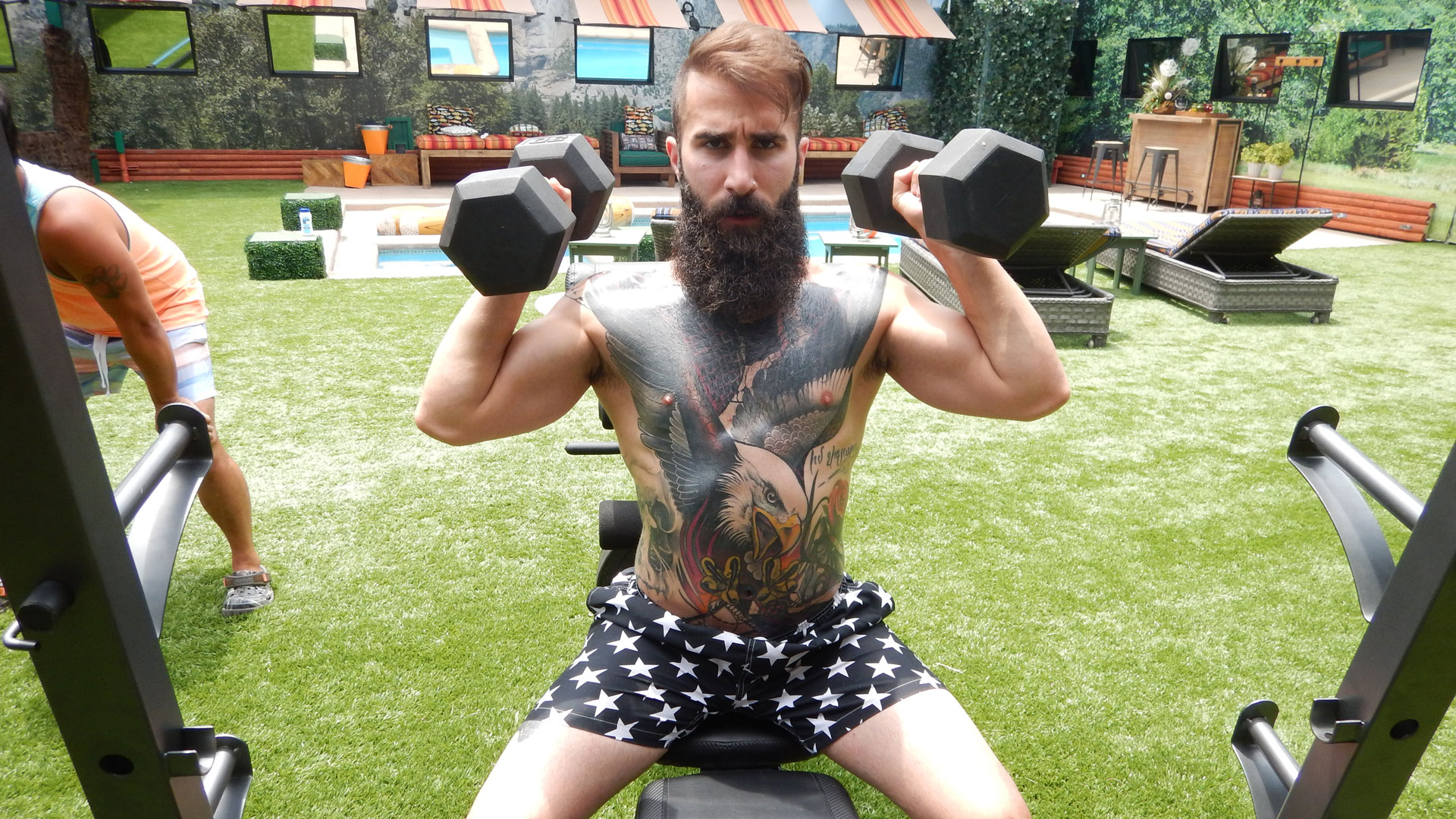 Paul pumps iron to work out his upper body.