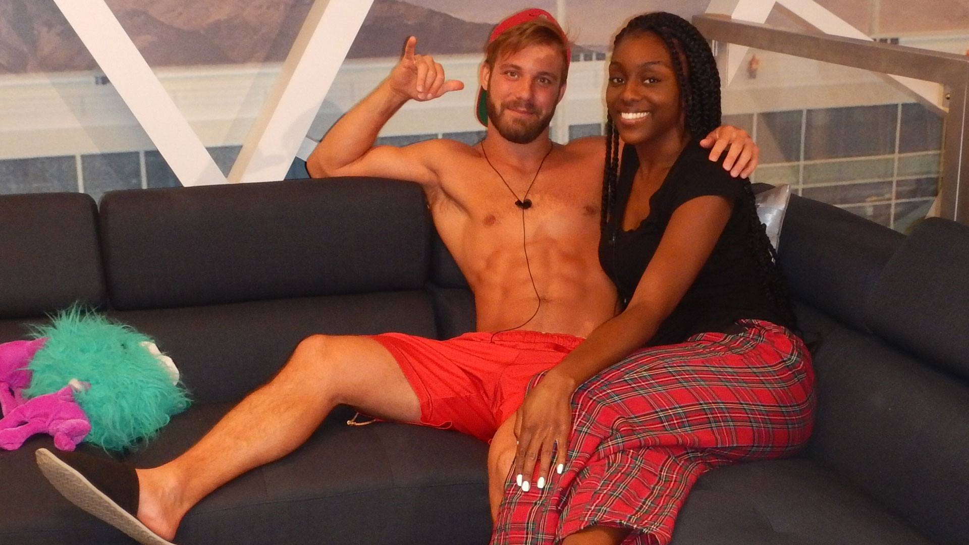 Paulie and Da'Vonne grab a spot on the couch and chill.