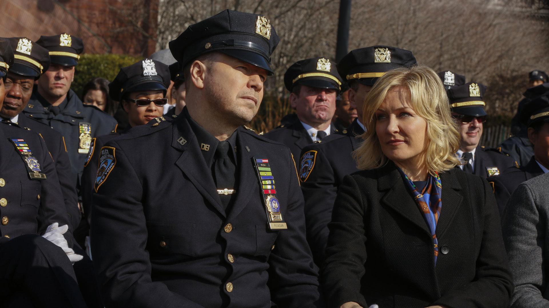 Linda Reagan joins Detective Danny Reagan at a ceremony.