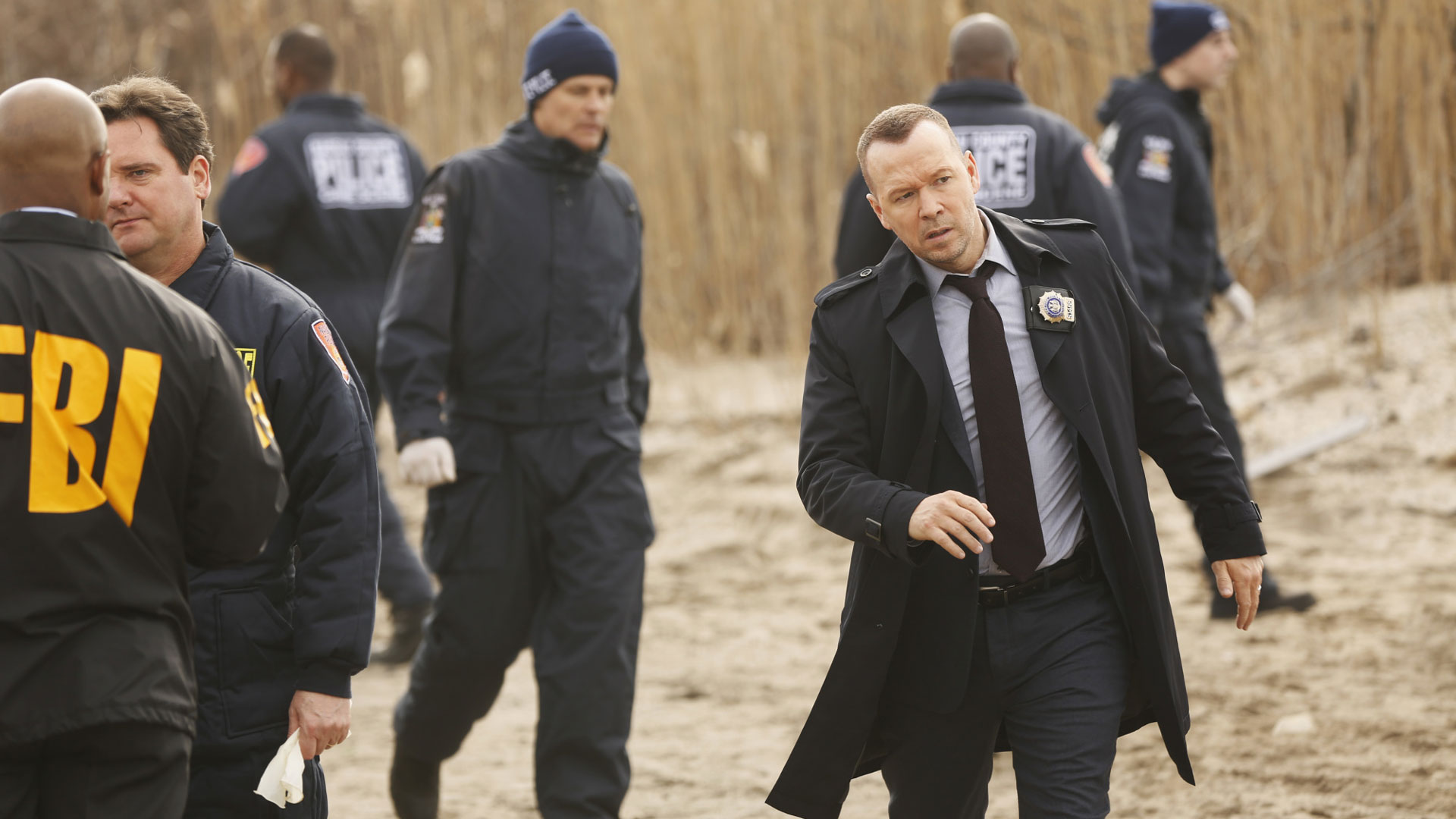 Detective Danny Reagan approaches a crime scene.