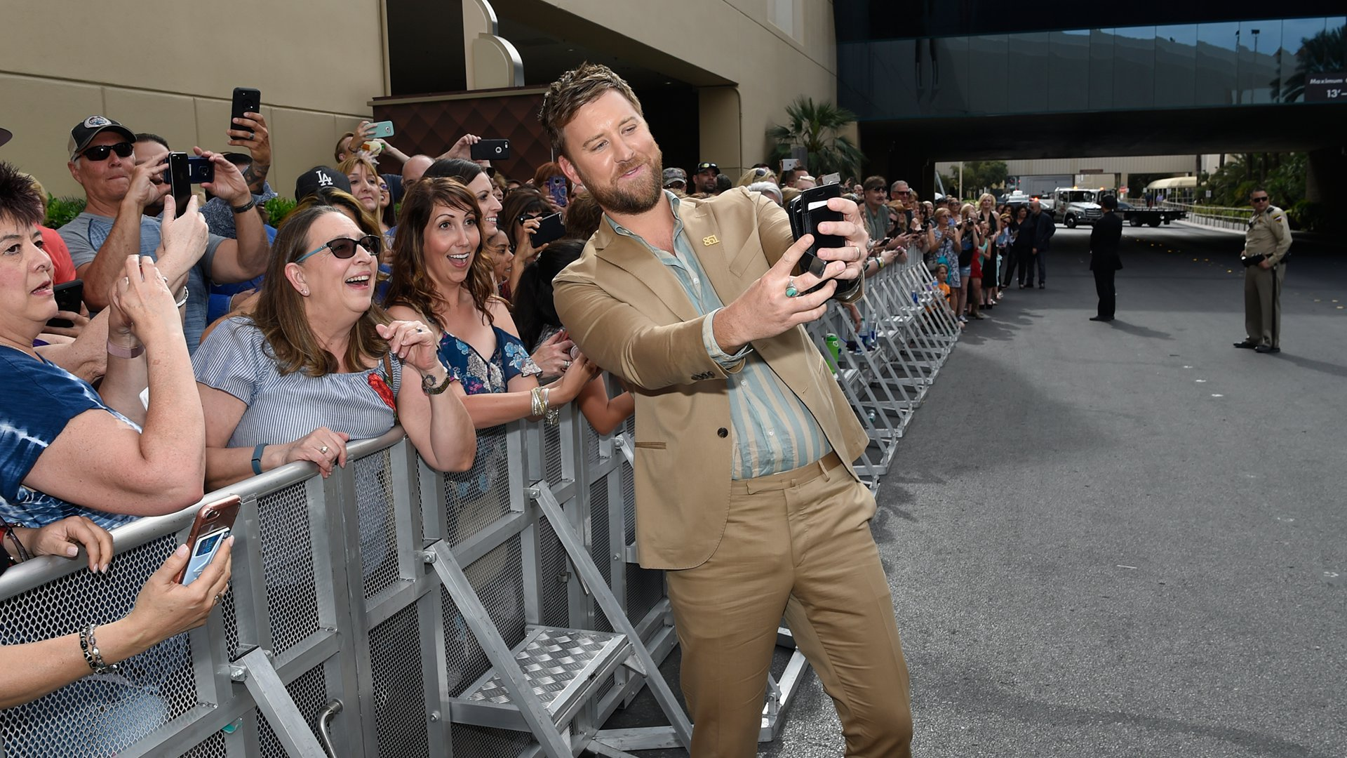 Lady Antebellum singer Charles Kelley warms up before his ACM performance by taking selfies with fans.