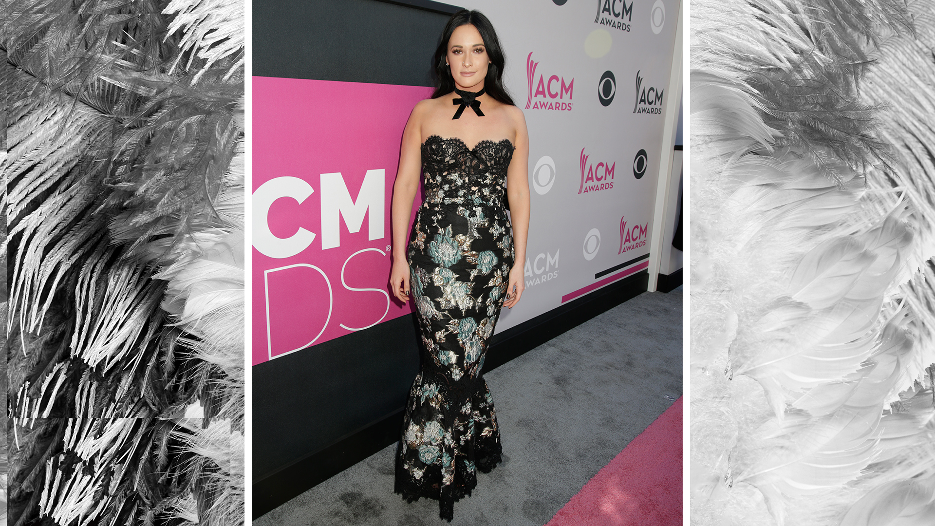 Kacey Musgraves poses on the red carpet in a gorgeous floral gown with lace accents.
