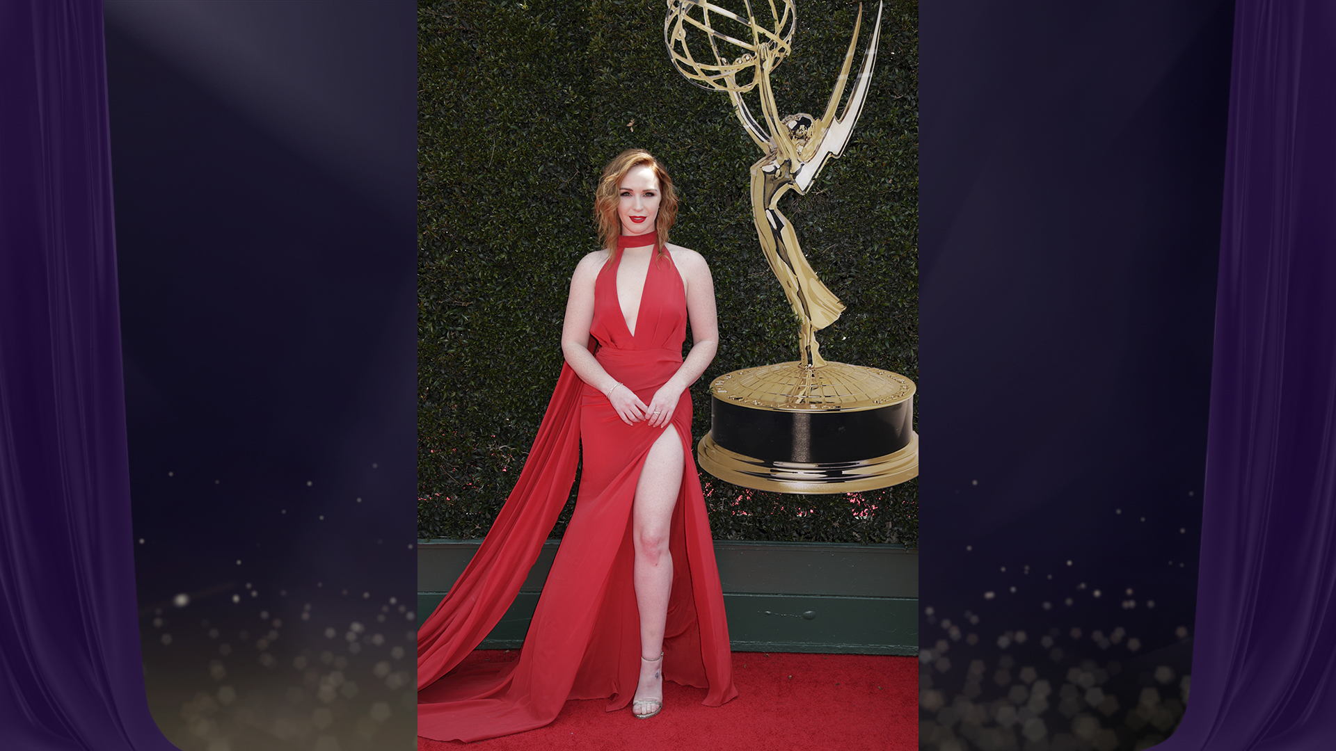 Y&R star Camryn Grimes, who's nominated for Outstanding Supporting Actress in a Drama Series, is giving us life in this sexy red dress with plunging neckline.