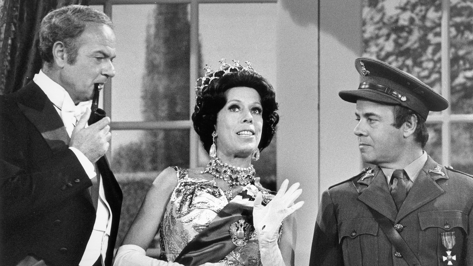 Carol Burnett is comedy royalty as Queen Elizabeth II, with Harvey Korman as the king, and Tim Conway as Private Newberry.