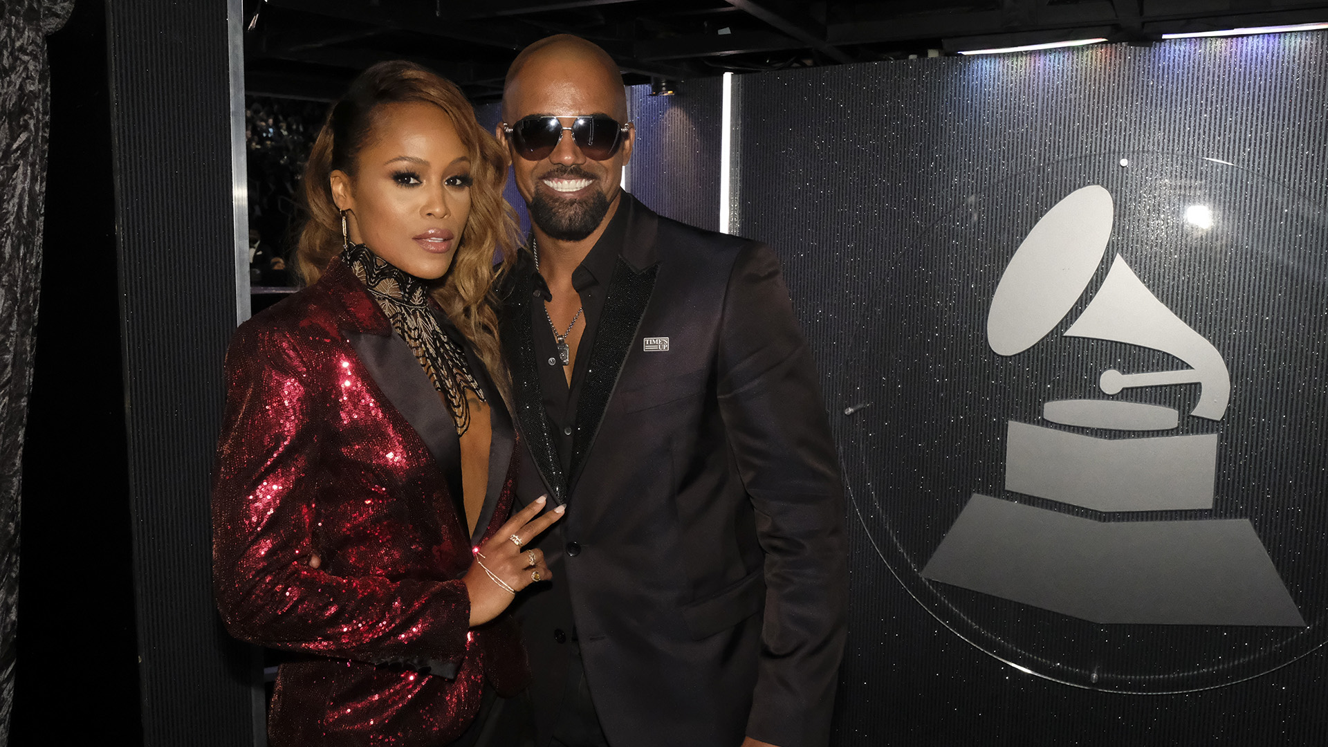 Rap Queen and The Talk host Eve poses for the camera with S.W.A.T. star Shemar Moore.
