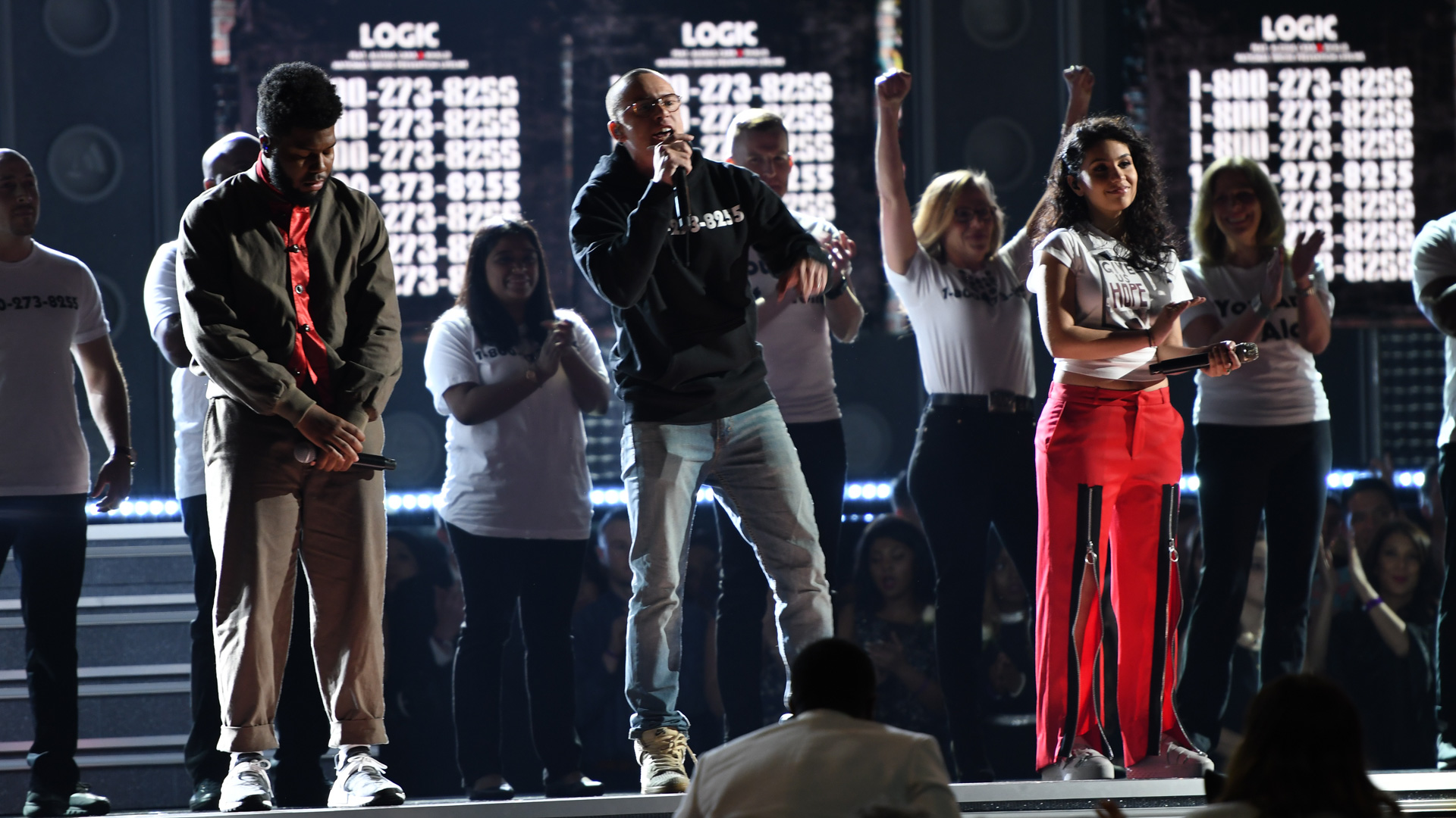 Alessia Cara, Khalid, and Logic join onstage to perform the poignant tune