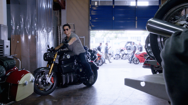 Some Five-0 crew members service their rides at Montgomery Powersports (featured in the episode).