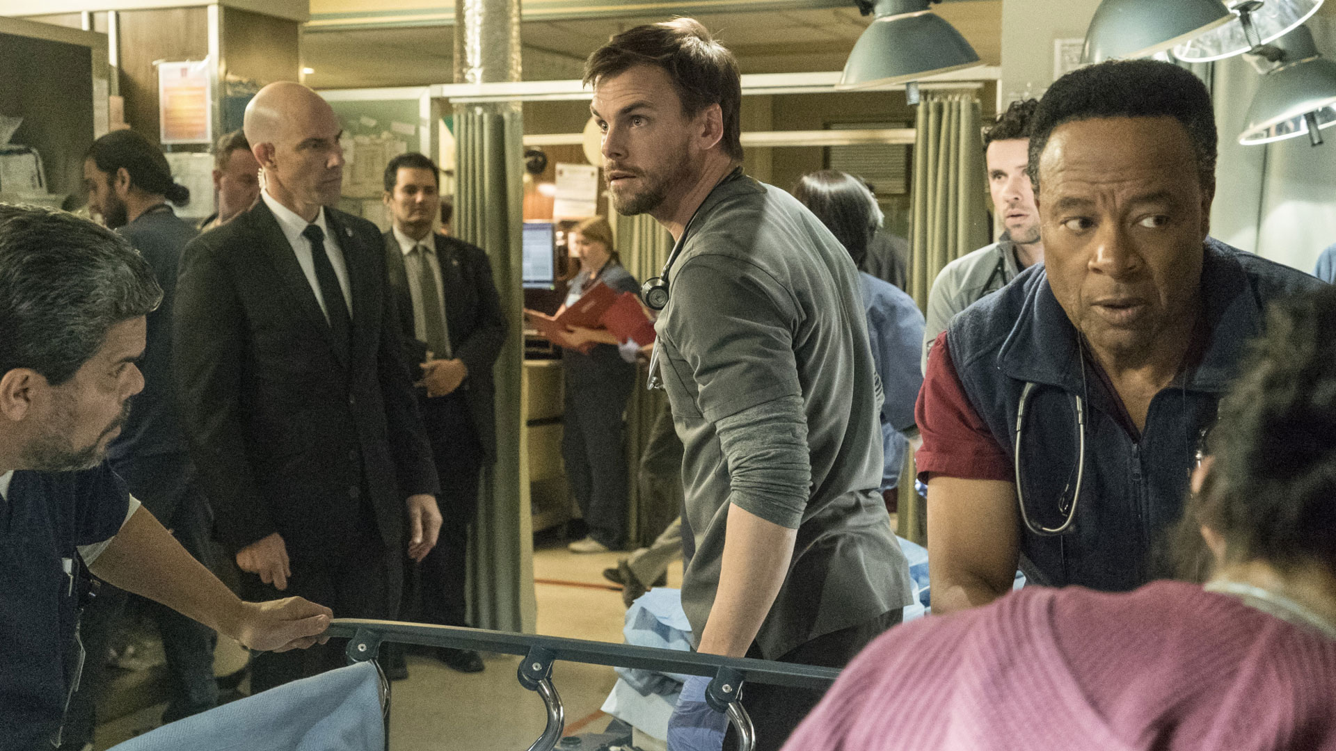 Luis Guzmán as Jesse Sallander, Tommy Dewey as Dr. Mike Leighton, and William Allen Young as Dr. Rollie Guthrie