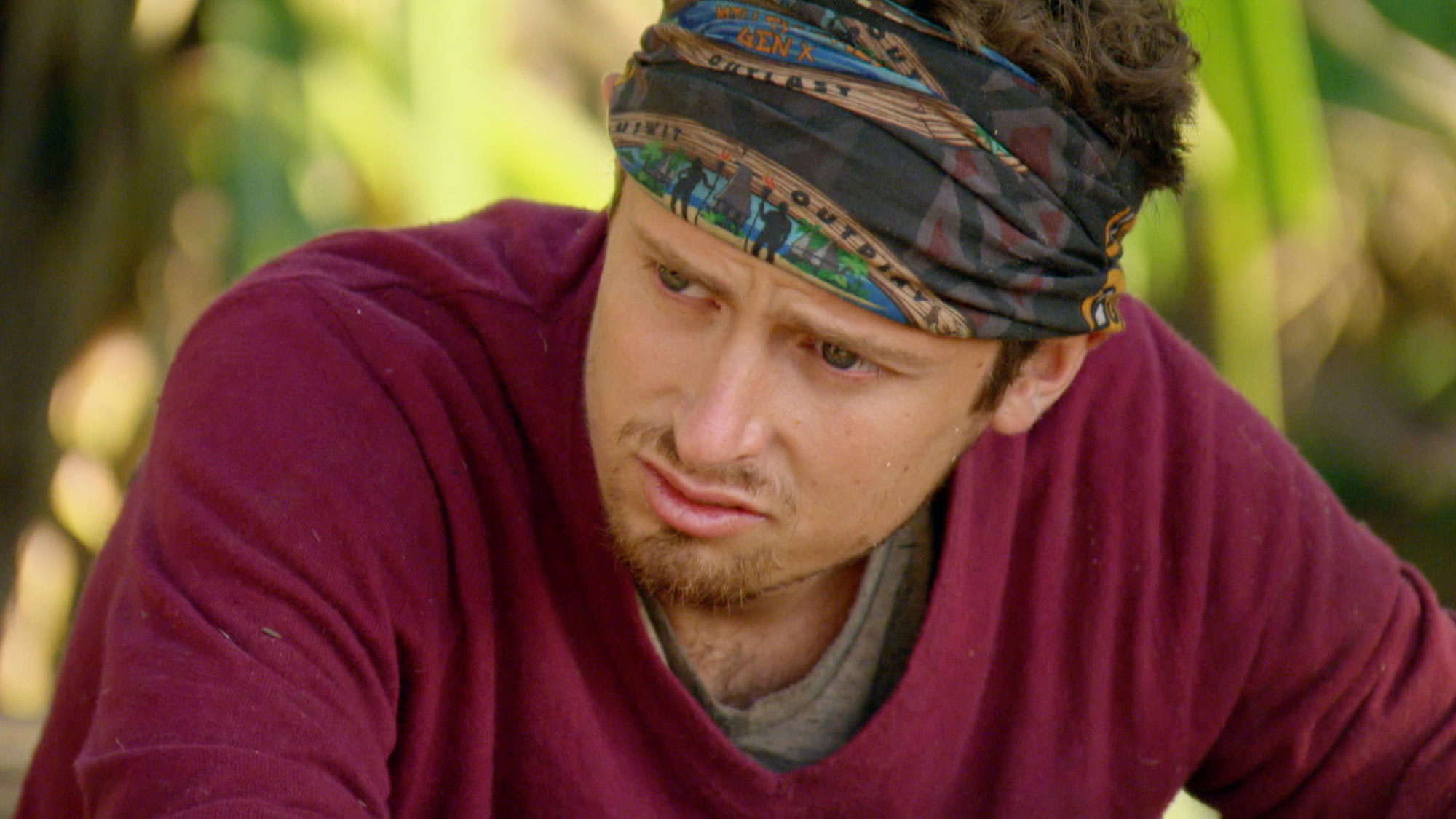 Adam's facial expression shows just how serious Survivor can be.