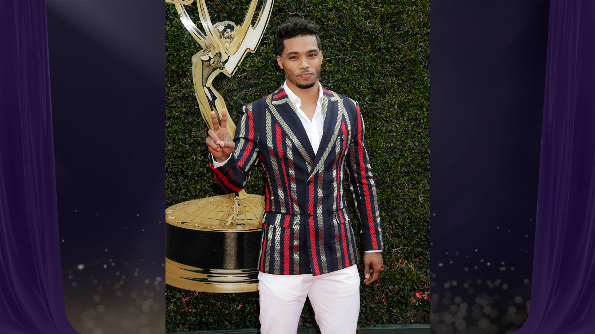 Rome Flynn from The Bold and the Beautiful is all about peace, love, and stripes on the Daytime Emmy red carpet.