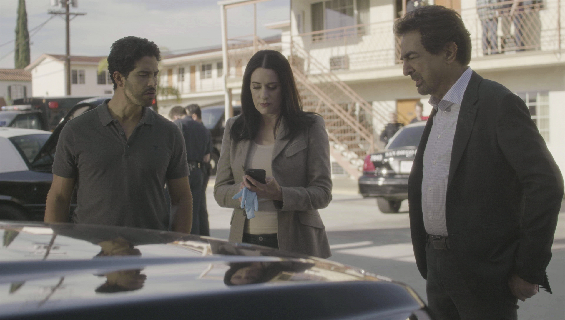 Alvez, Prentiss, and Rossi listen to Garcia's news.