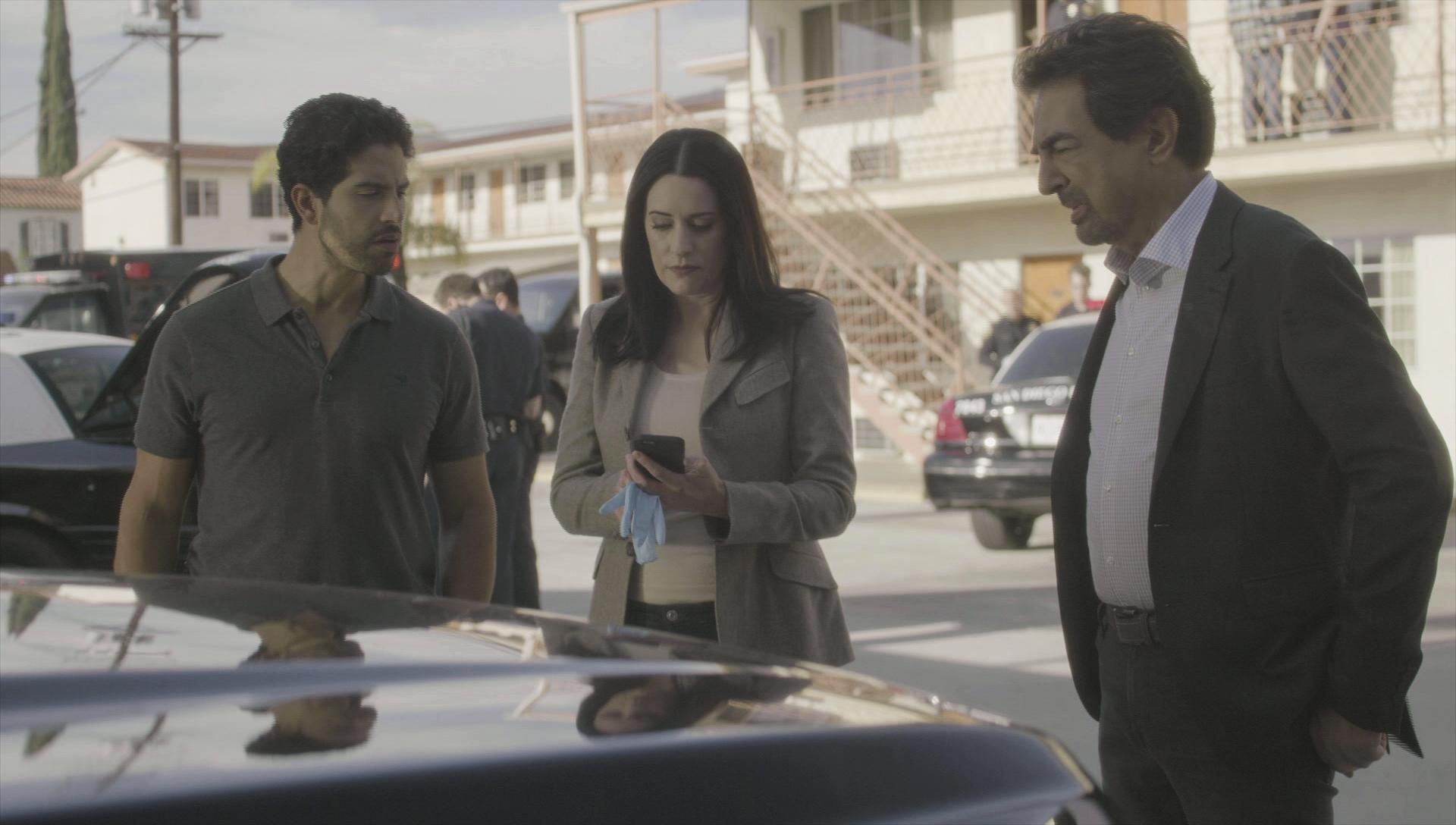 Alvez, Prentiss, and Rossi listen to Garcia's news.