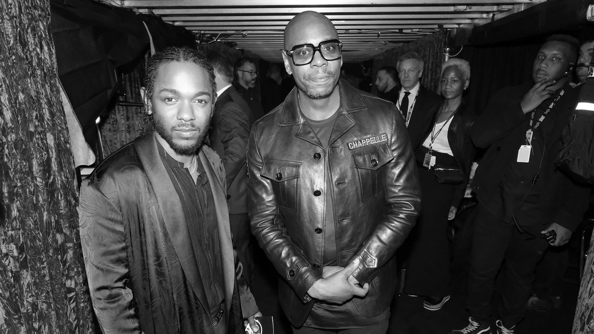 GRAMMY performer and Best Rap Album winner Kendrick Lamar poses with comedian Dave Chapelle.