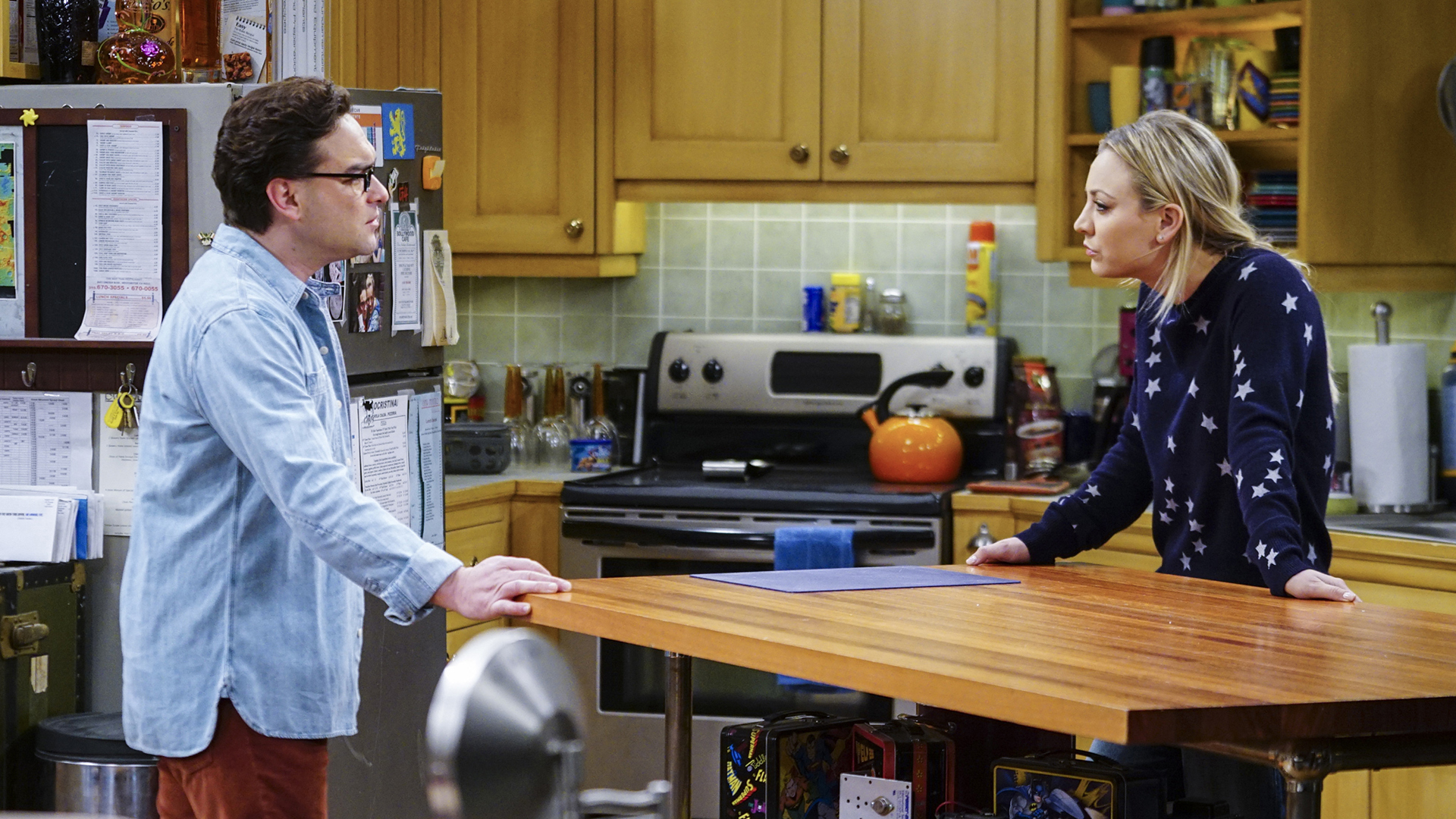 Leonard and Penny find themselves at a standstill in the kitchen.