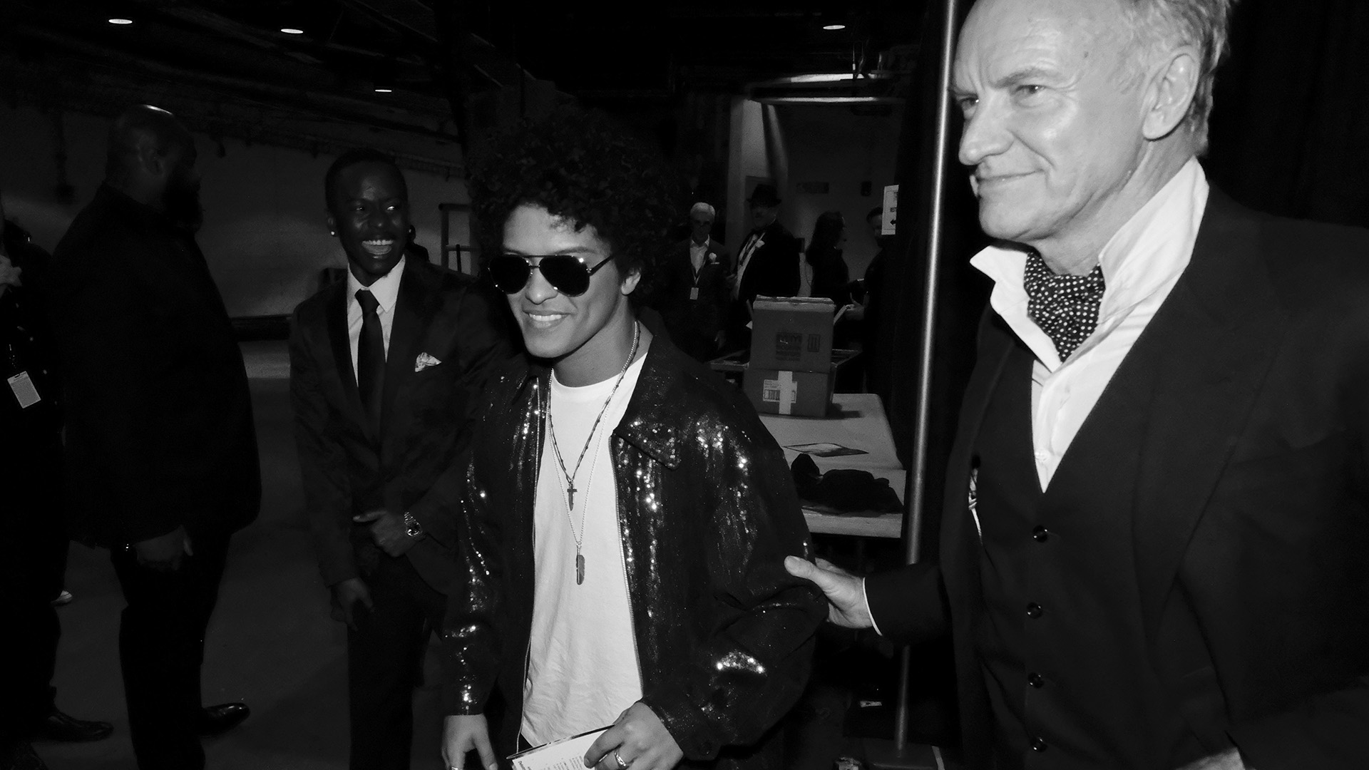 Bruno Mars, who took home multiple golden gramophones during the 60th Annual GRAMMY Awards, hangs backstage with Sting.