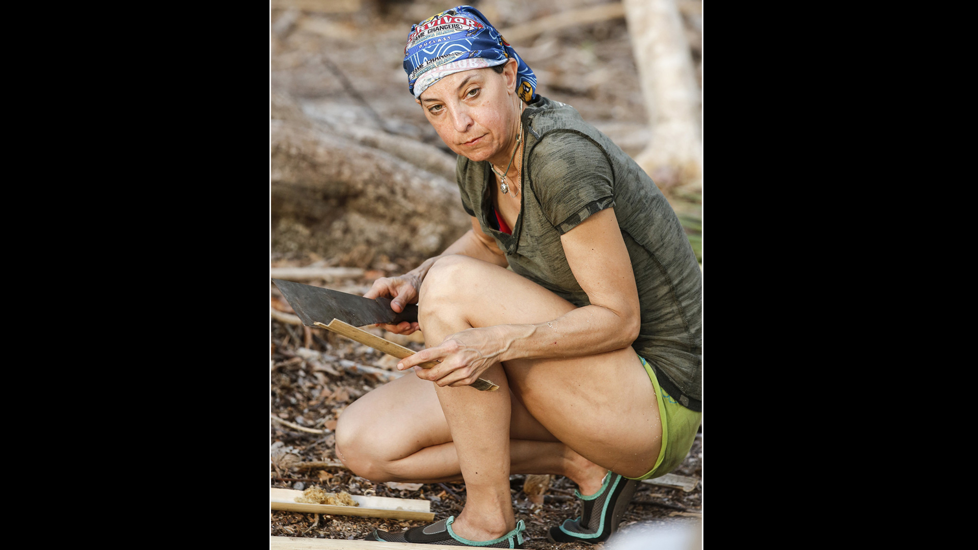 Survivor: Kaoh Rong former castaway Debbie Wanner kneels down and gets to work.