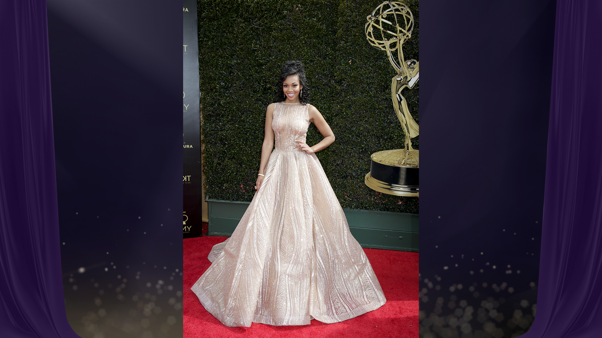 Y&R star Mishael Morgan, who's nominated for Outstanding Supporting Actress in a Drama Series, rocks a glittery high-neck gown with detailed beading.
