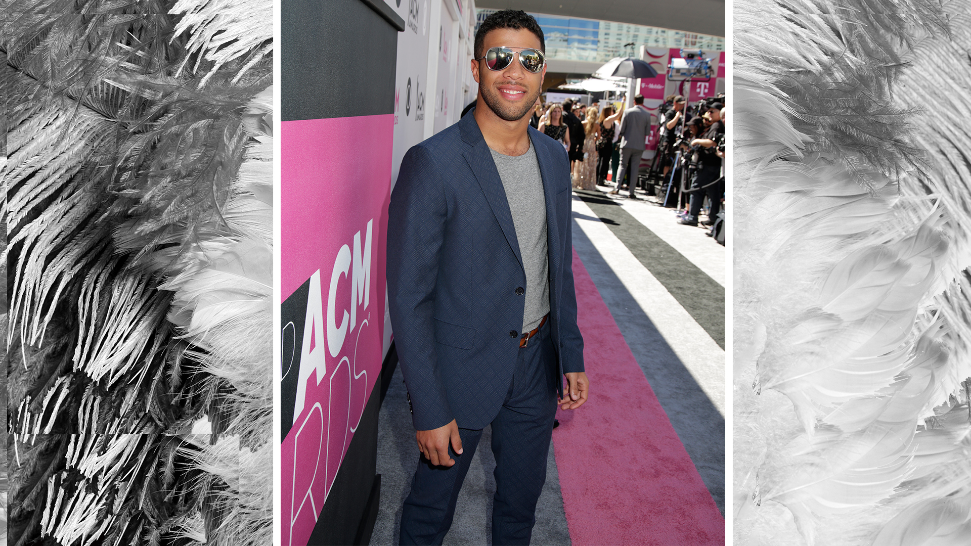 NASCAR driver Bubba Wallace keeps it cool in aviator sunglasses and a crewneck tee.