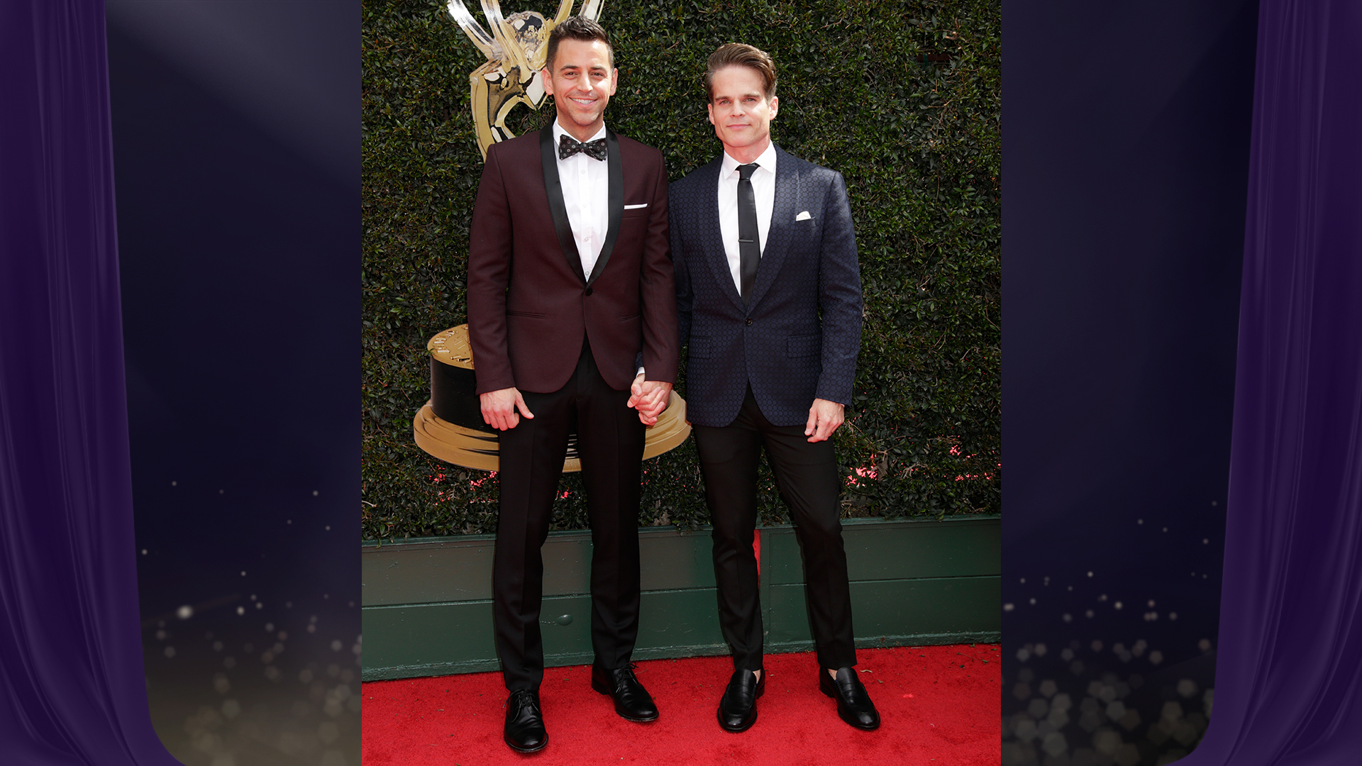 Greg Rikaart, who's nominated for Outstanding Supporting Actor in a Drama Series for his work on The Young and the Restless, holds hands with his husband before the big event.