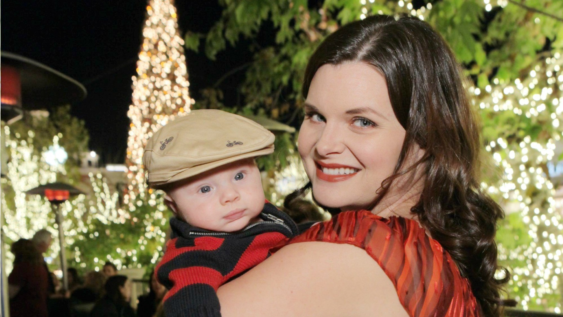 Katie holds her darling son.