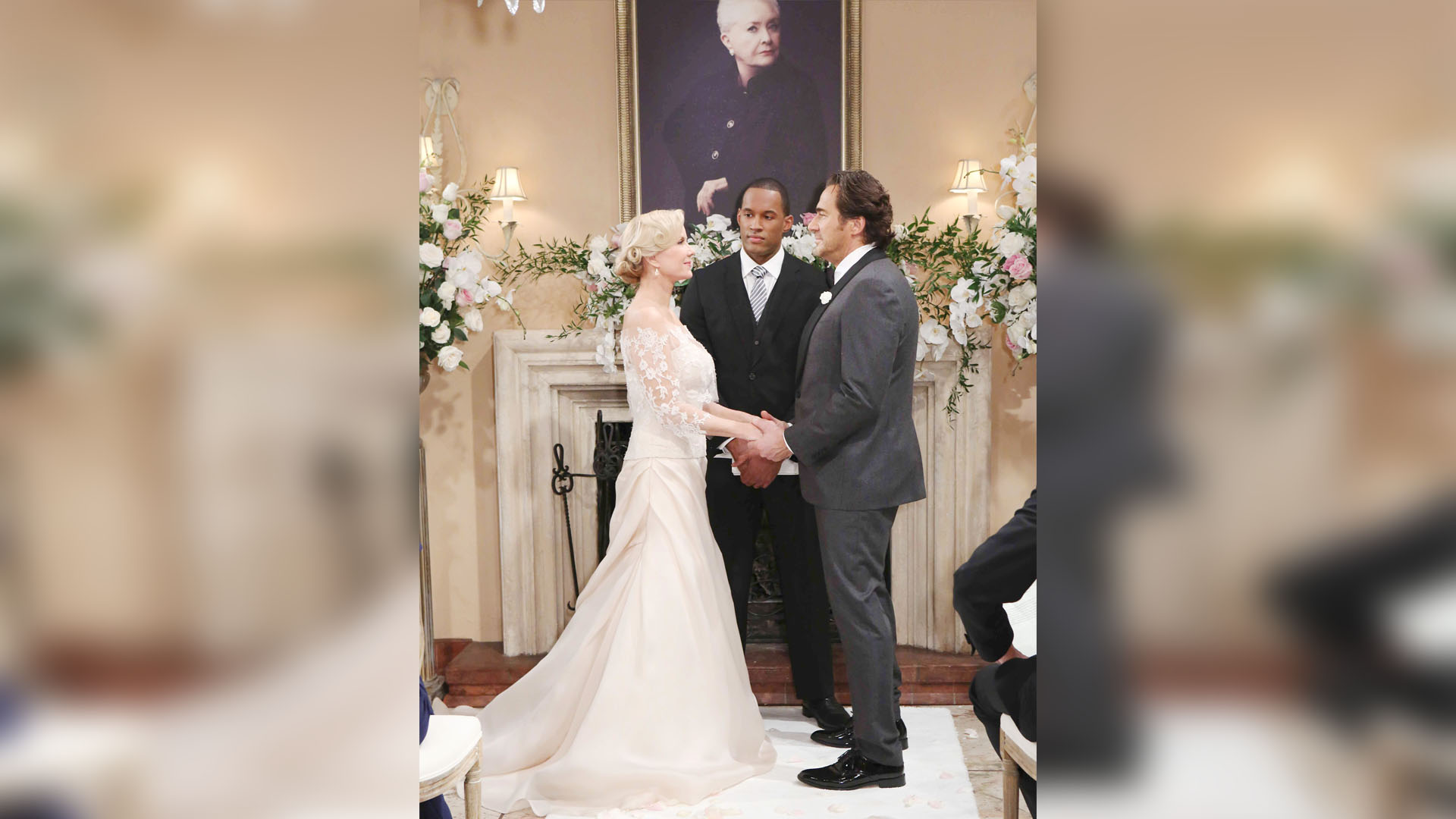 Surrounded by family and friends, and with a familiar face above the fireplace, Brooke and Ridge's wedding begins.