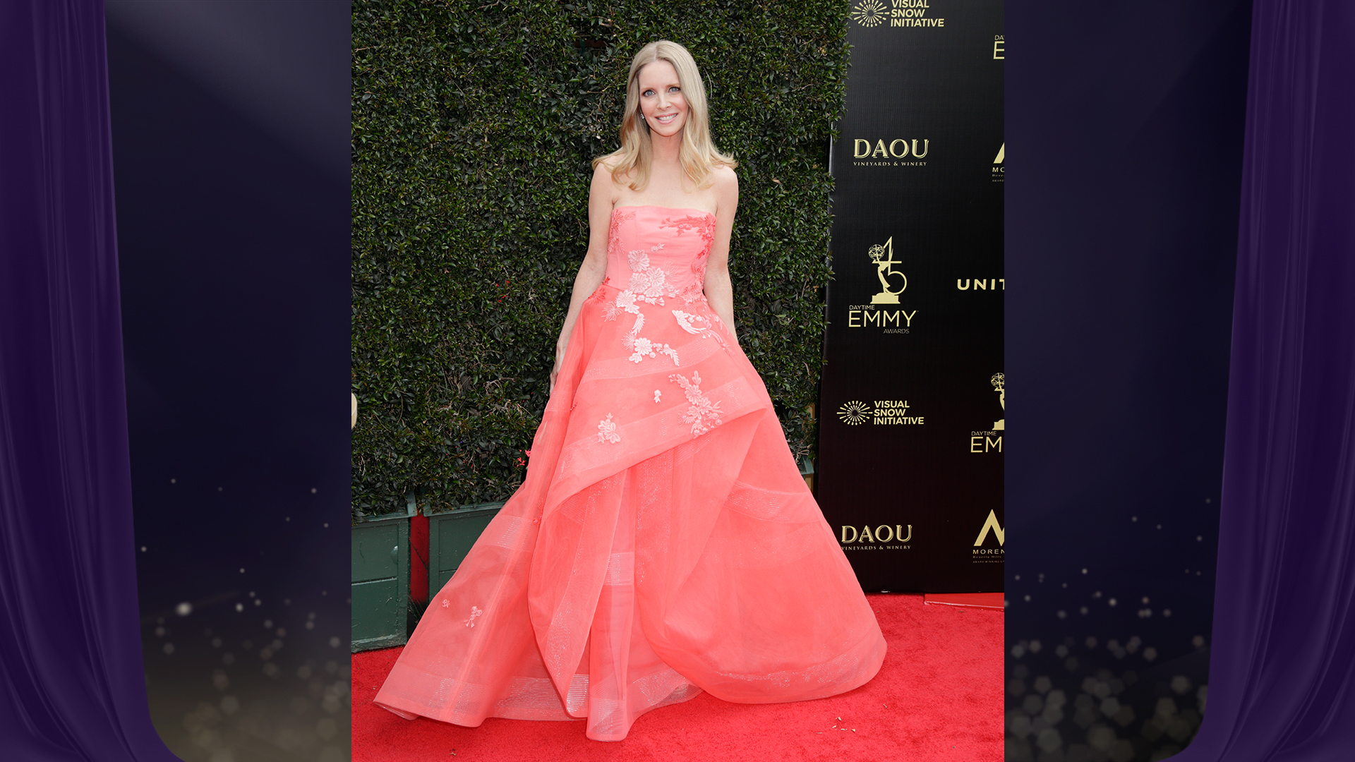 Lauralee Bell from The Young and the Restless glides down the red carpet in a pink strapless gown.